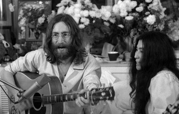John Lennon Seen Here With And Wife Yoko Ono At Their 1969 Bed In