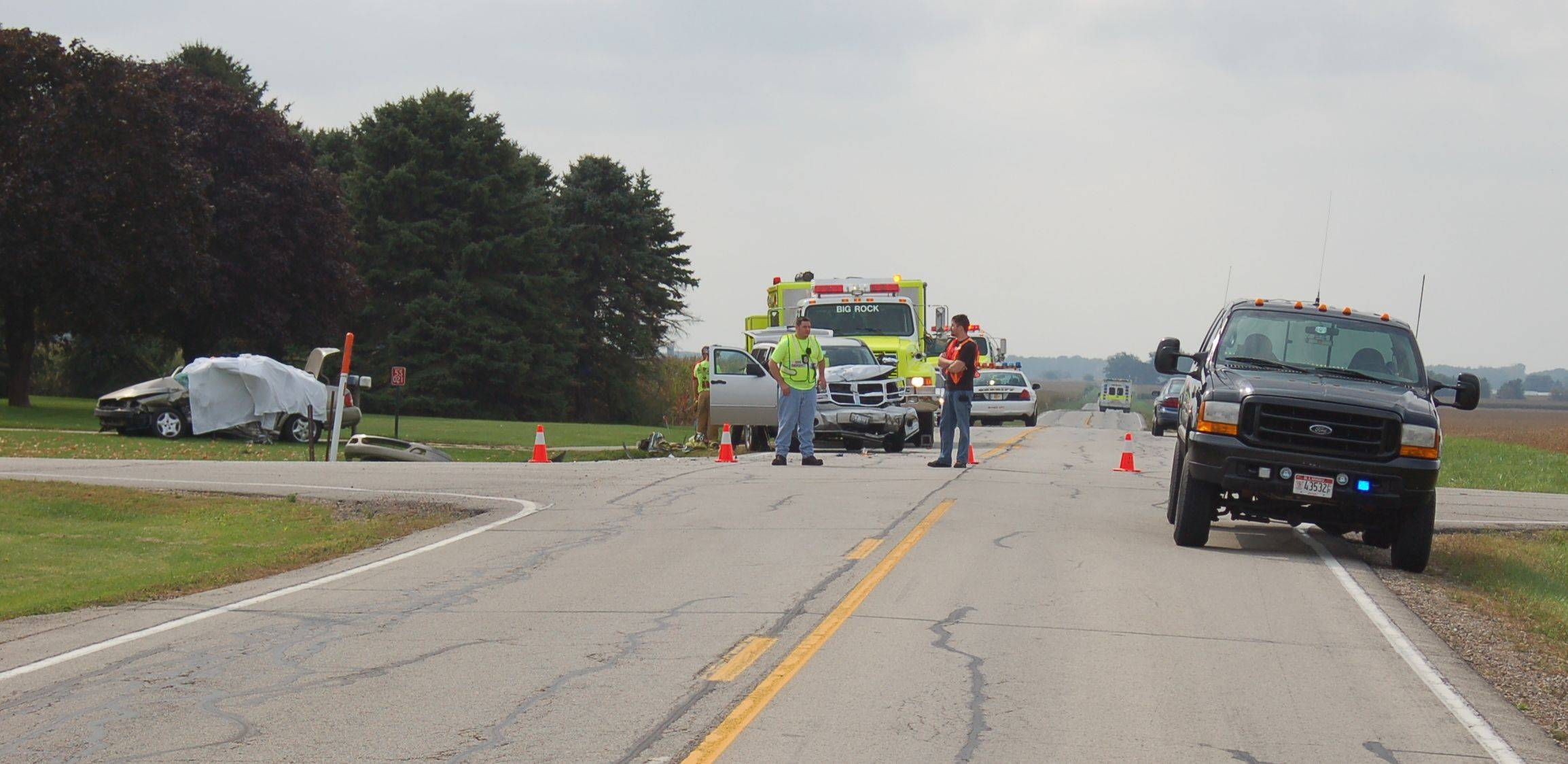 Authorities investigate a crash in Big Rock Township in September 2008. Distracted driving was a likely cause, officials said.