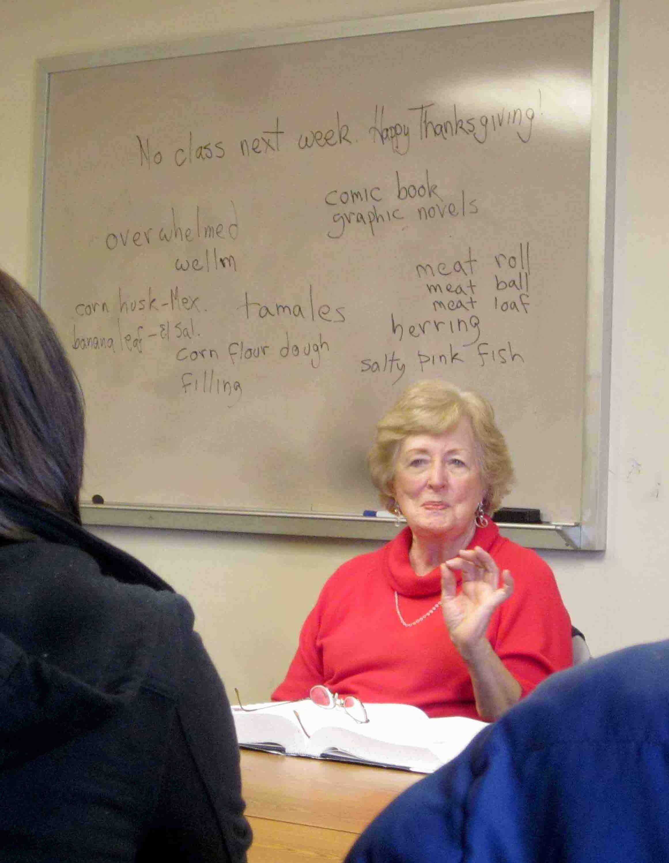 Patricia Bernhold of Wheaton gives a lesson about the proper way to say food-related terms -- such as lettuce, meatball and corn flour -- in English to adults studying the language Saturday at People's Resource Center in Wheaton. Bernhold has volunteered at the center for about eight years.