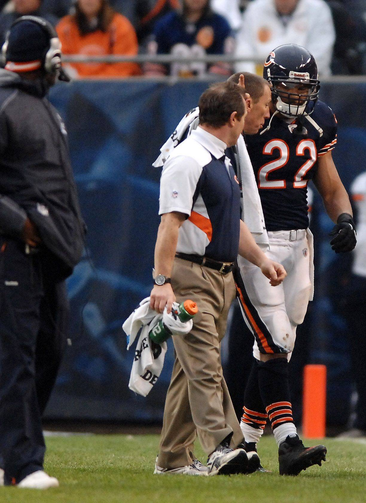 Bears running back Matt Forte walks off the field after an injury to his right knee in the first quarter Sunday at Soldier Field.