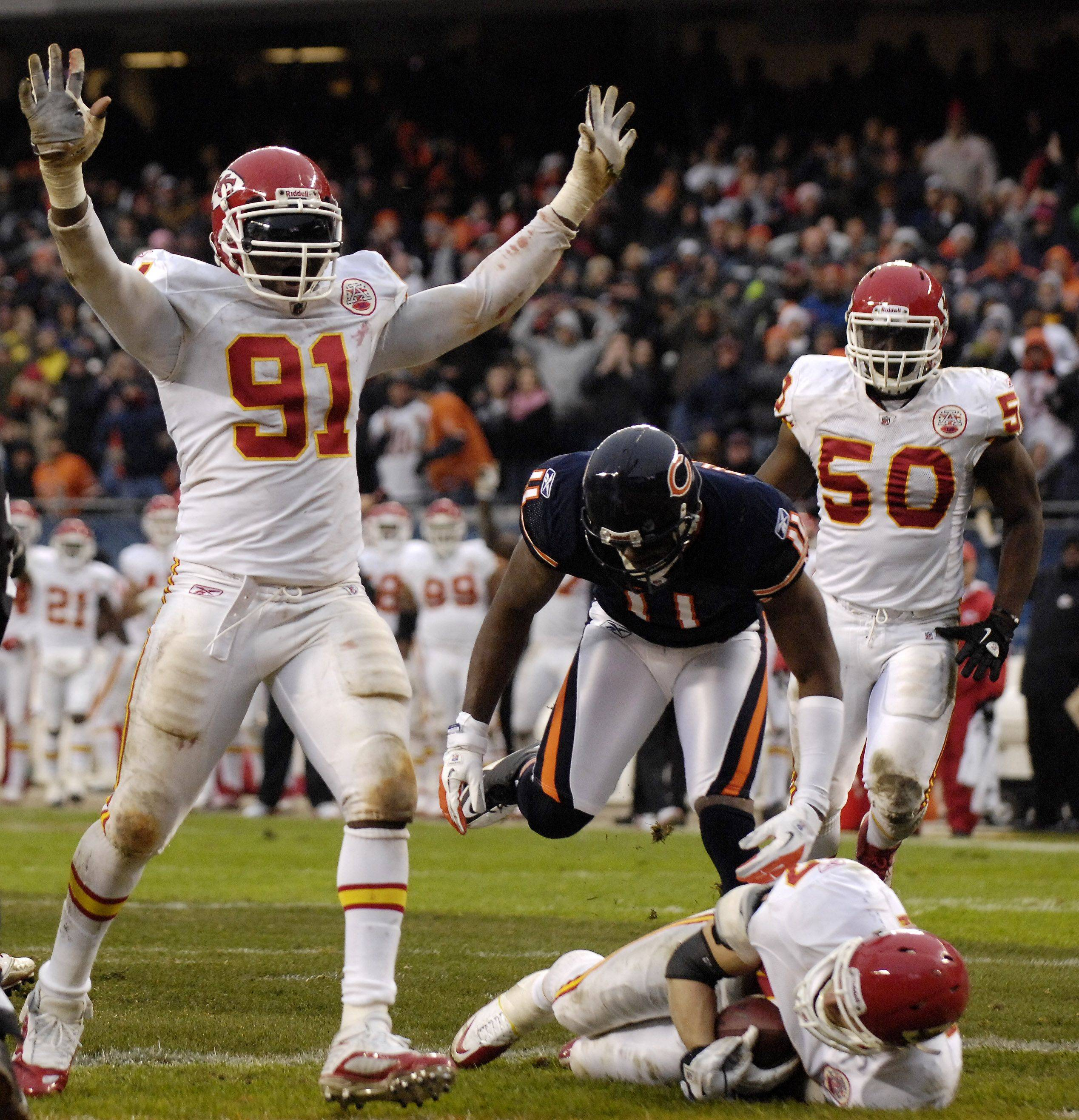 Kansas City Chiefs outside linebacker Tamba Hali (91) celebrates after teammate Jon McGraw pulled in an interception that went off the hands of Chicago Bears wide receiver Roy Williams (11) late in the fourth quarter of Sunday's game at Soldier Field in Chicago.
