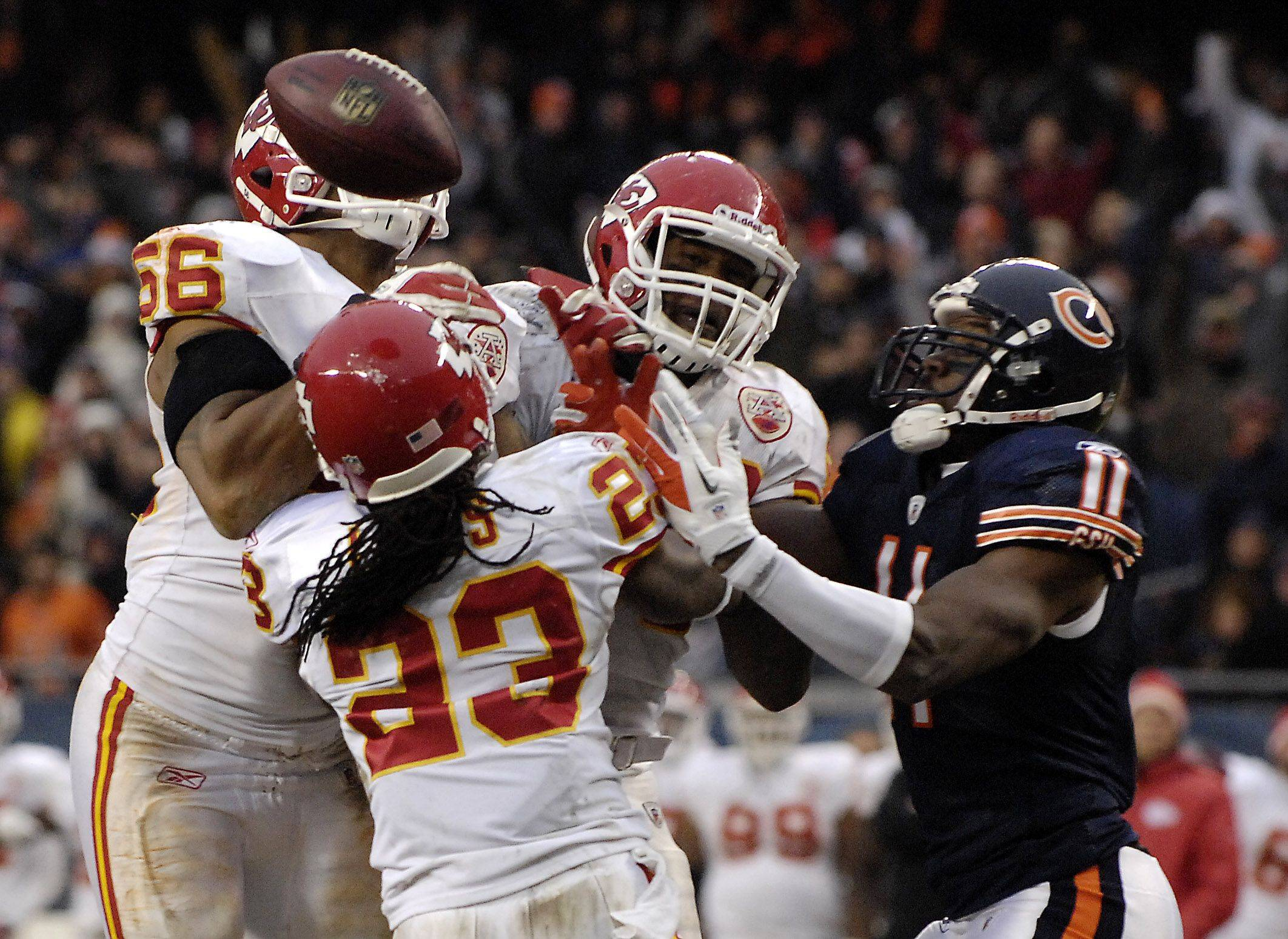Three Chiefs defenders clamor for the ball after it went off the hands of Chicago Bears wide receiver Roy Williams (11) during Sunday's game at Soldier Field in Chicago. It was intercepted in the end zone by the Chiefs.