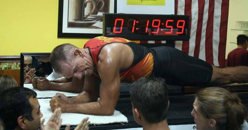 George Hood, 53, of Aurora, set the new Guinness World record in the plank, at 1 hour, 20 minutes, 5.01 seconds at the Eggsperience restaurant in Naperville on Saturday Dec.3, 2011.