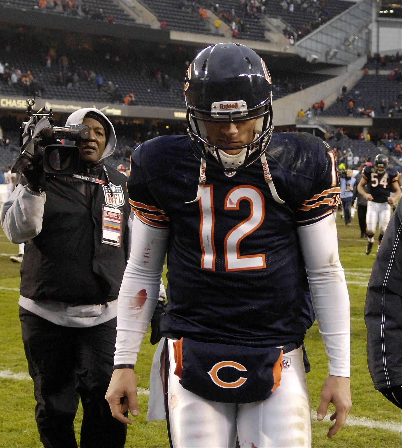 Chicago Bears quarterback Caleb Hanie (12) walks off the field after Sunday's loss to Kansas City at Soldier Field.