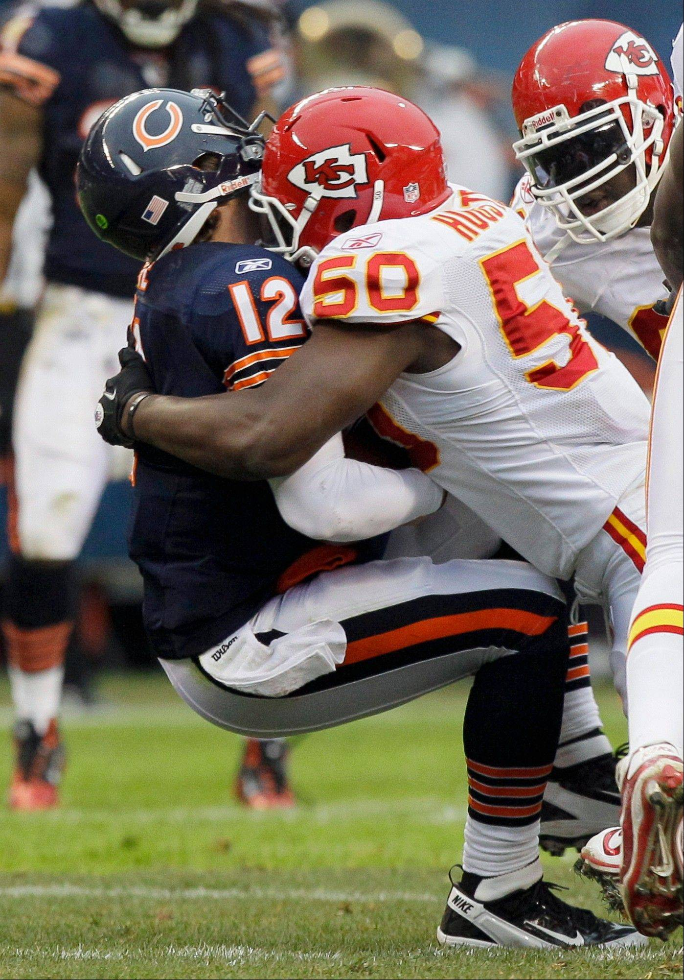 Bears quarterback Caleb Hanie (12) is sacked by Kansas City Chiefs linebacker Justin Houston (50) in the first half of an NFL football game in Chicago, Sunday, Dec. 4, 2011.