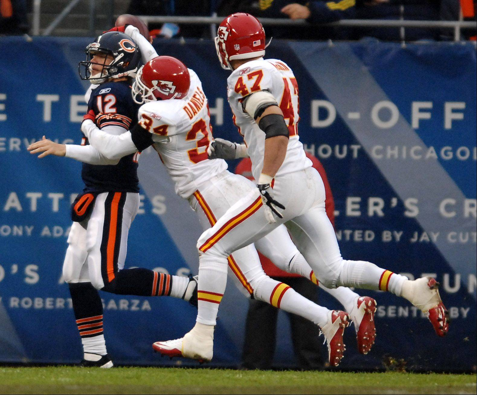 Rick West/rwest@dailyherald.comChicago Bears quarterback Caleb Hanie (12) is grabbed by Kansas City Chiefs defensive back Travis Daniels (34) as he tries to throw in the second quarter during Sunday's game at Soldier Field in Chicago.