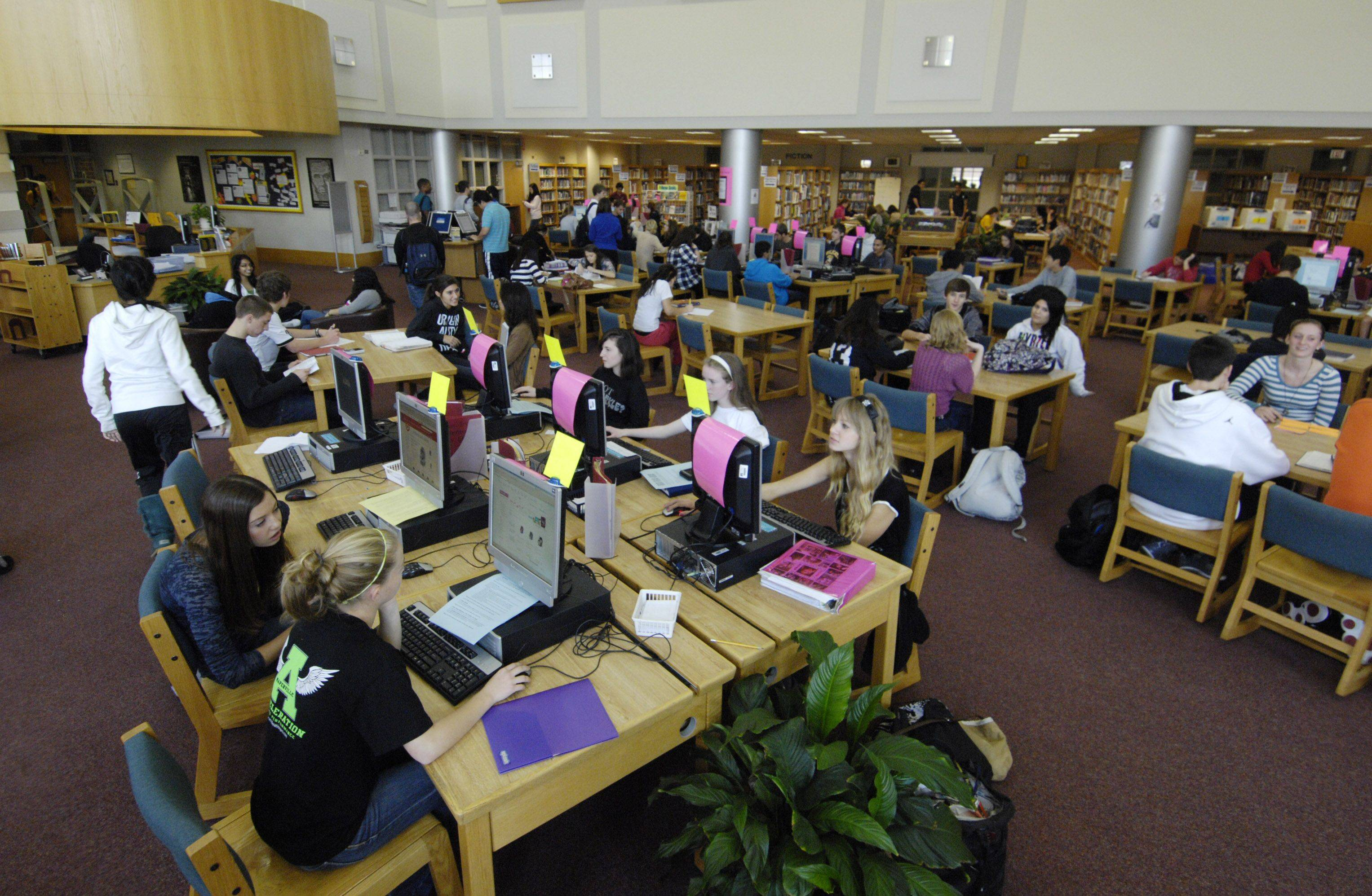 Neuqua Valley High School, one of the state's most successful on test performance, has less class time than many of the suburbs' lower-ranked schools. During an option period, the library is filled with students. They also can go to resource rooms or the cafeteria during that period.