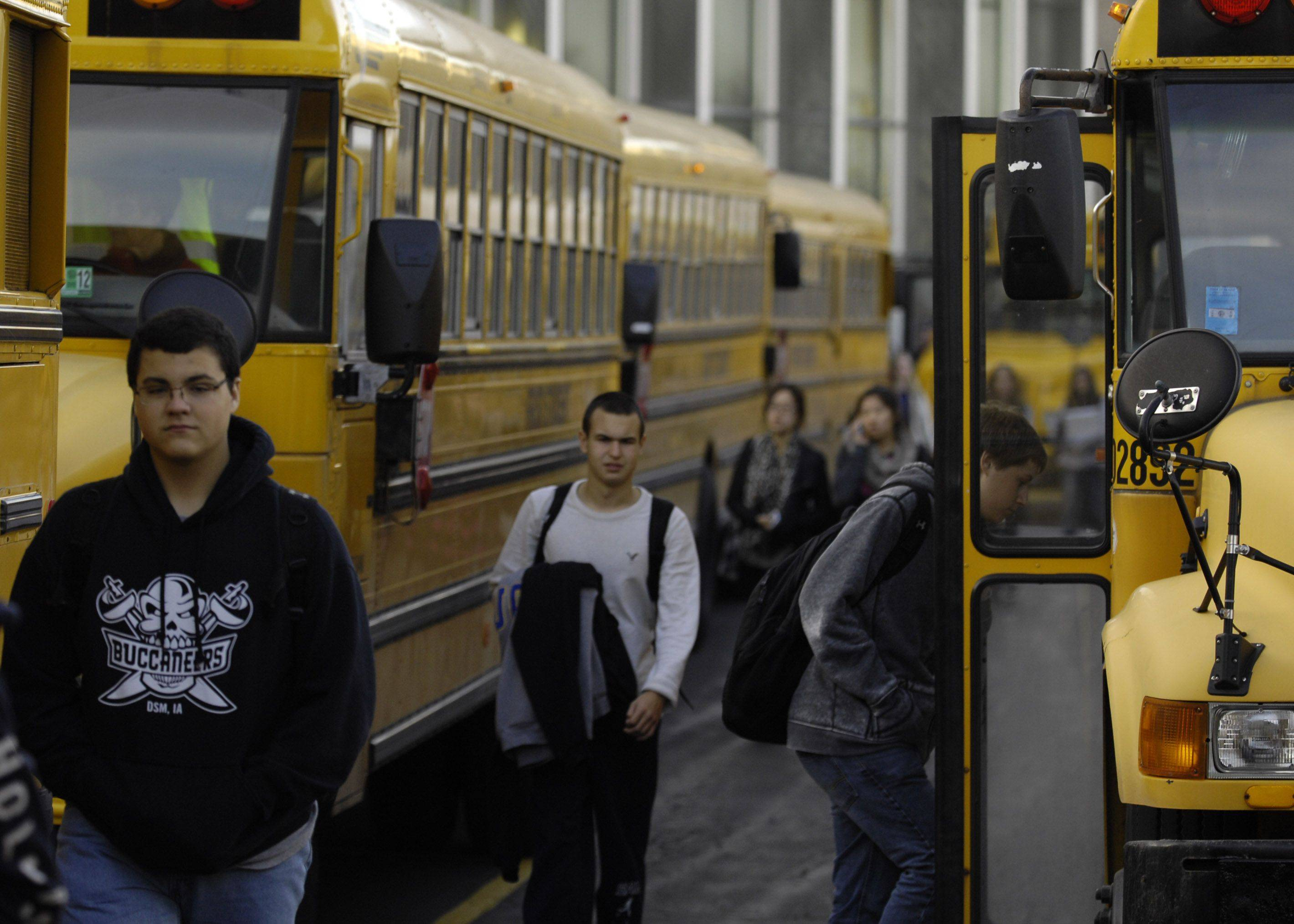 Students get on the bus after school at Stevenson High School. The school is one of the top-ranked in the state on test performance. Only 4.2 percent of Stevenson students are considered low-income.