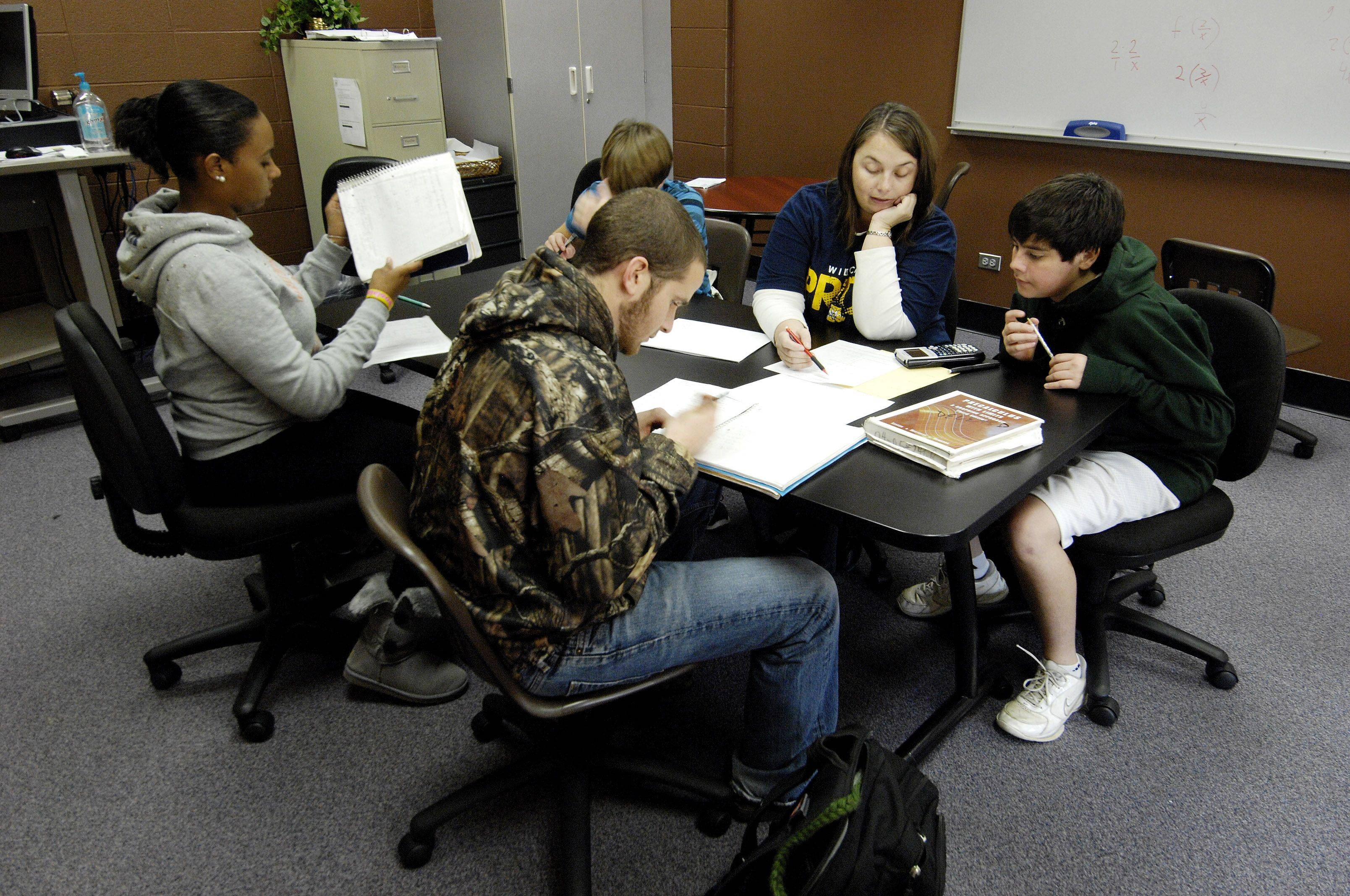 Neuqua Valley High School math teacher Sheila Roth works with students in the math resource room. Students have several choices when deciding what to do during their option periods.