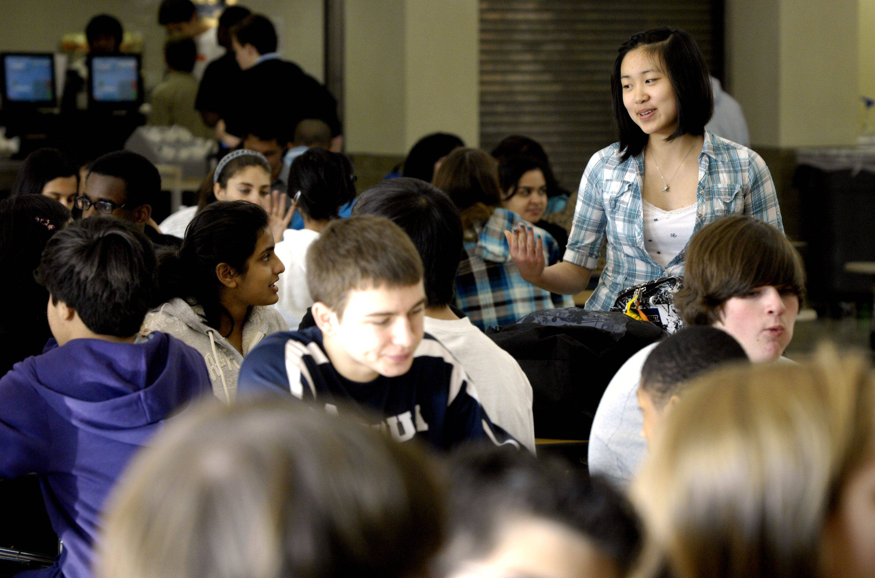 Neuqua Valley High School student Lucy Chen, 16, eats lunch with her friends during an option period.