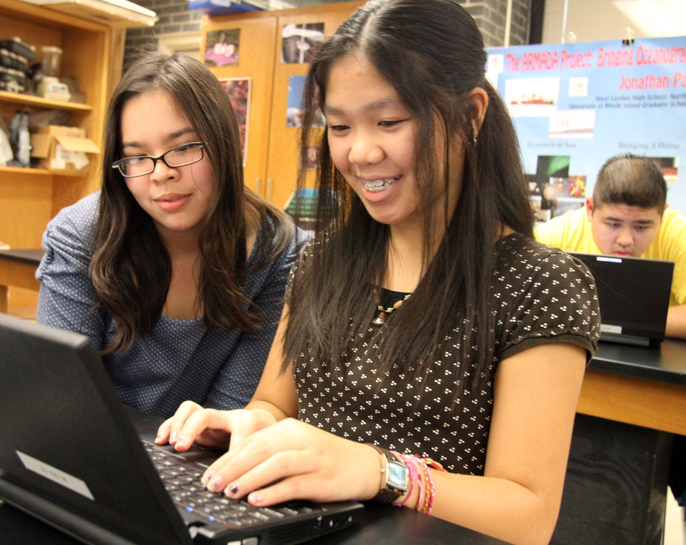 Deanna Gonzalez, a junior at West Leyden High School in Northlake, left, mentors freshman Jenine Agoncillo during a required extra period for freshmen after school.