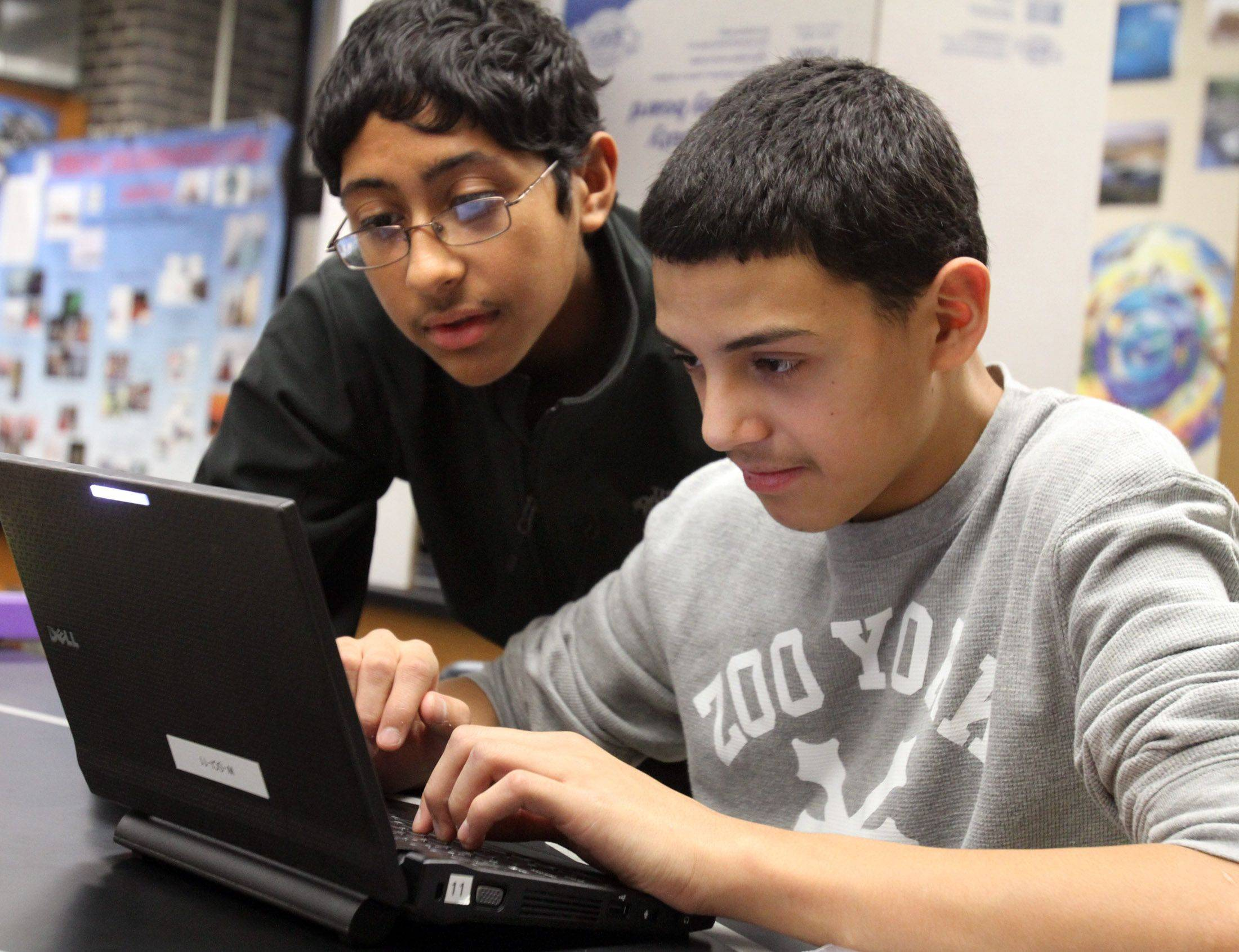 Stephen Mayorga, a junior at West Leyden High School, left, mentors freshman Alexis Diaz during a required extra period for freshmen after school.