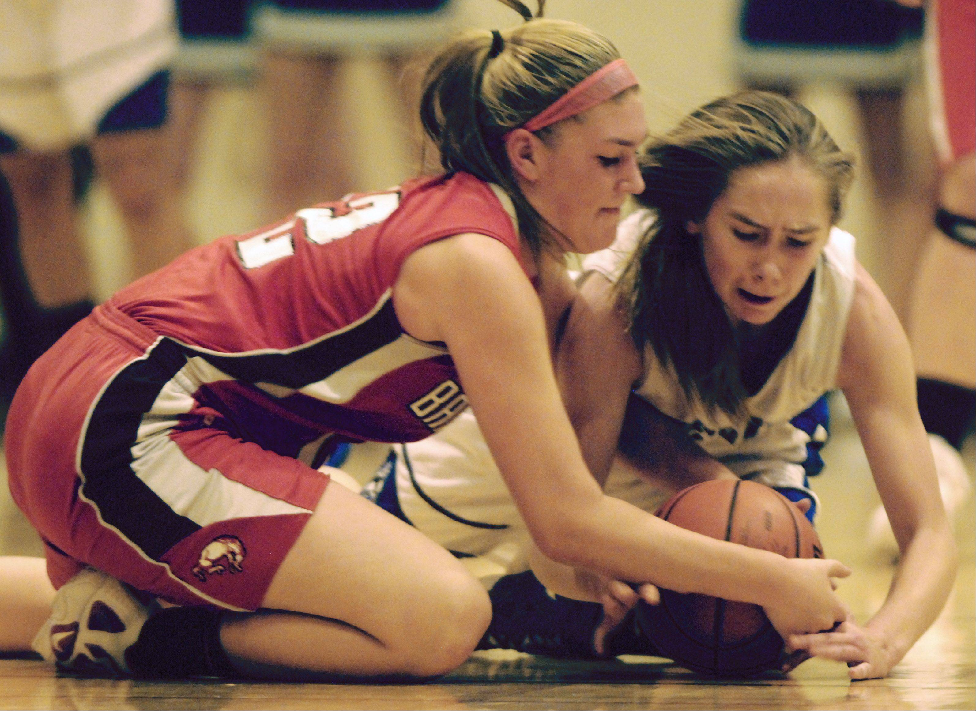 Barrington's Maddie Bartz, left, and Wheeling's Hailey Dammeier hit the floor chasing a loose ball during Tuesday's game.