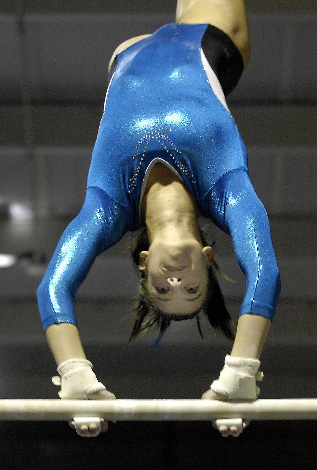 Geneva's Jenna Ginsberg competes in the uneven bars during Monday's girls gymnastics meet in Batavia.