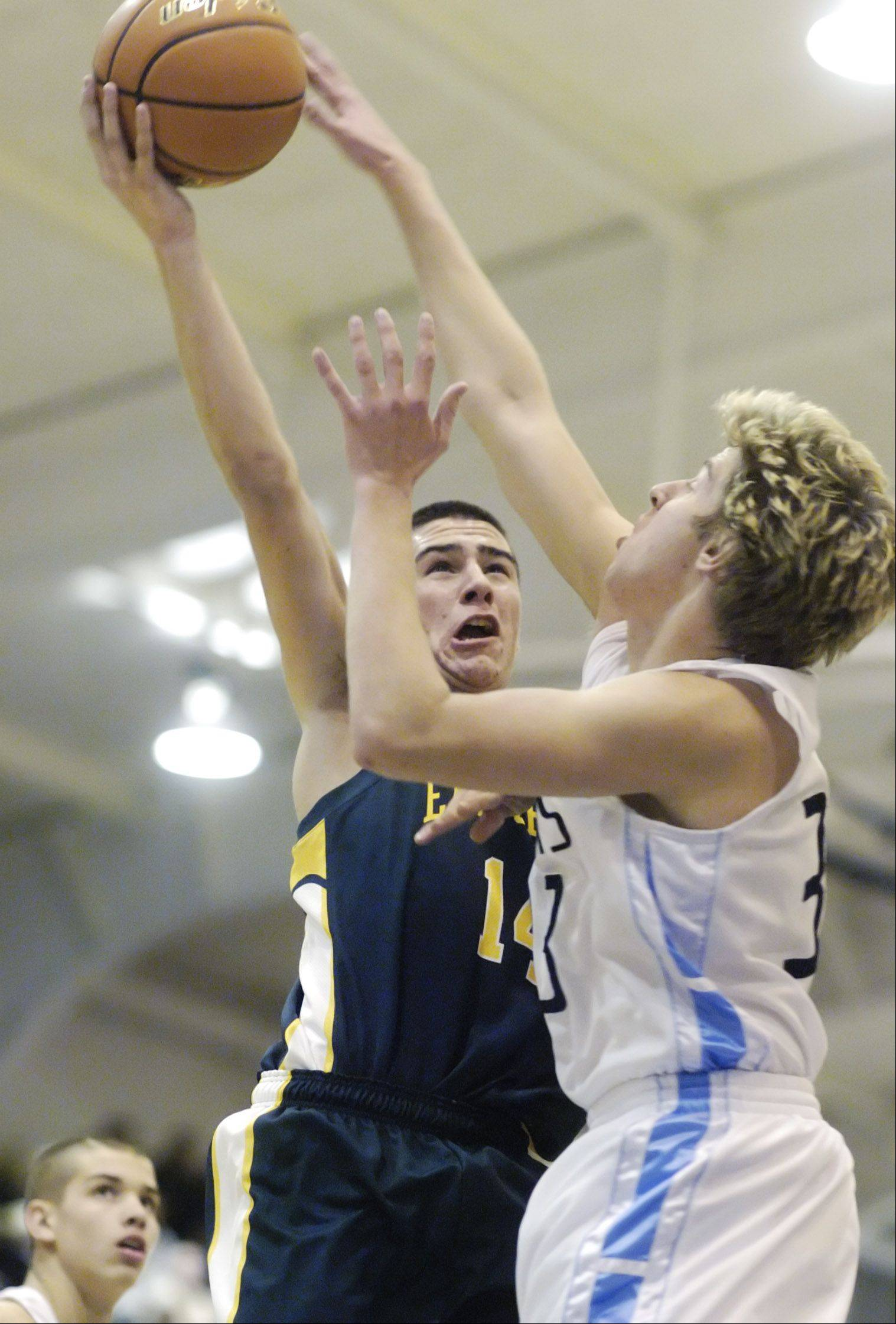 Elk Grove's Zachary Solorio drives to the basket against Prospect's Kevin Somogyi.