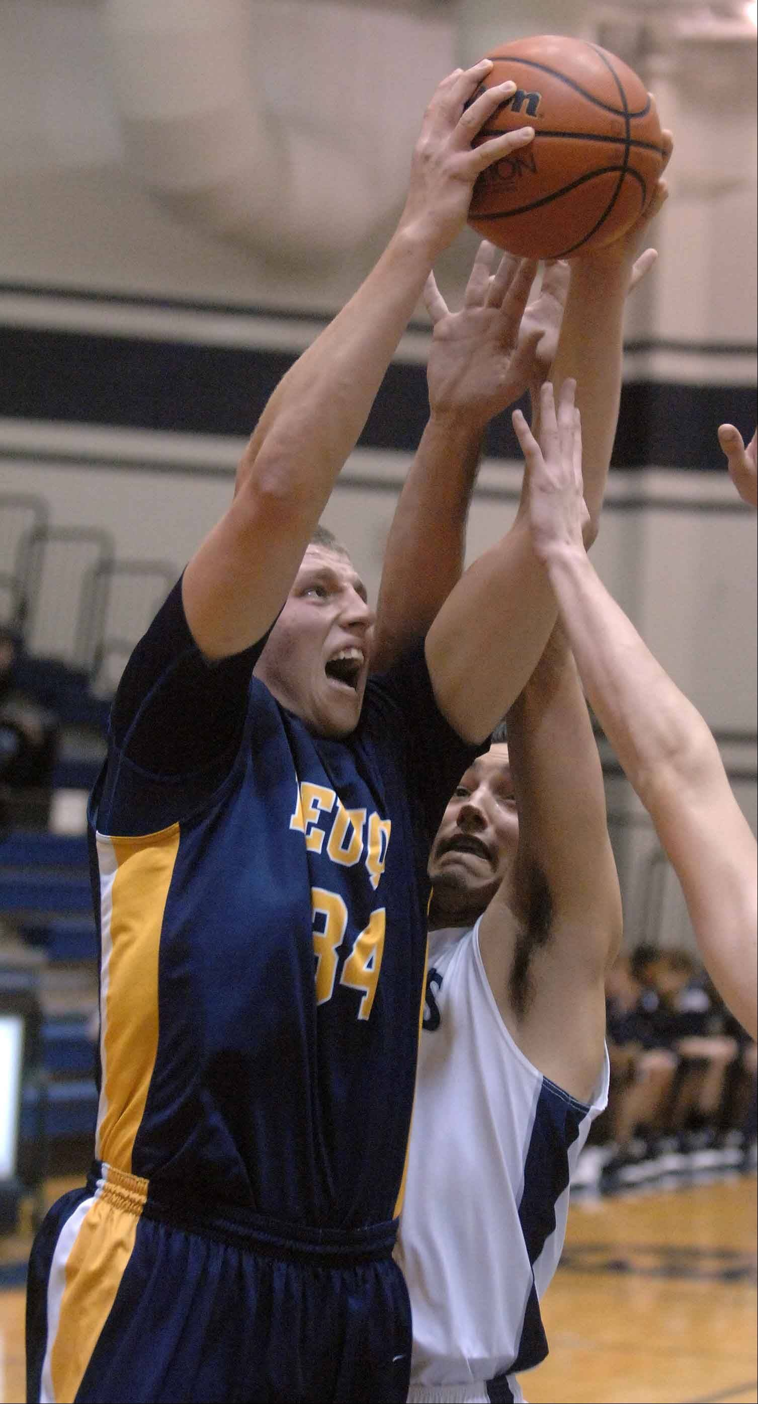 Pat Kenny of Neuqua Valley goes up for a rebound during Friday's boys basketball game against Lake Park in Roselle.