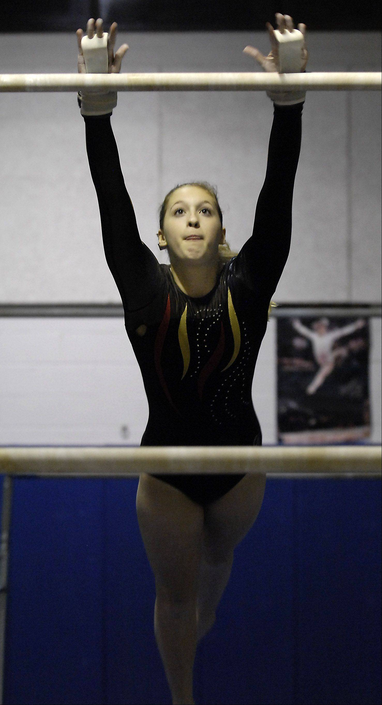 Batavia's Kristy Zabka competes in the uneven bars during Monday's girls gymnastics meet in Batavia.