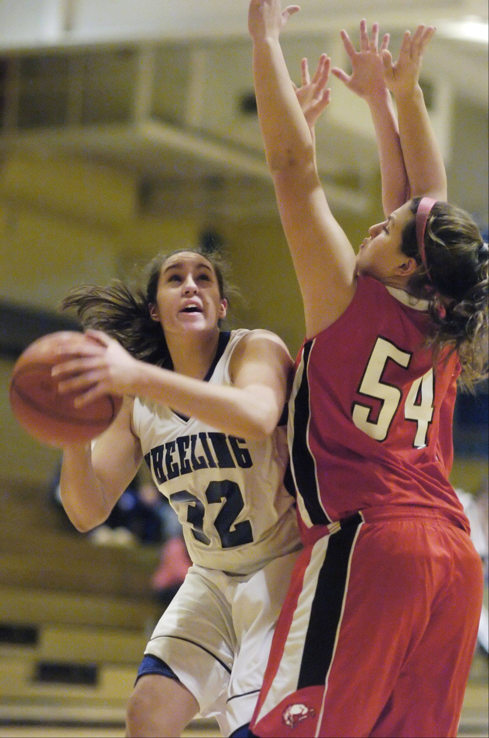 Wheeling's Kellie Kuzmanic looks for a shot against the defense of Barrington's Alexa Resch Tuesday.