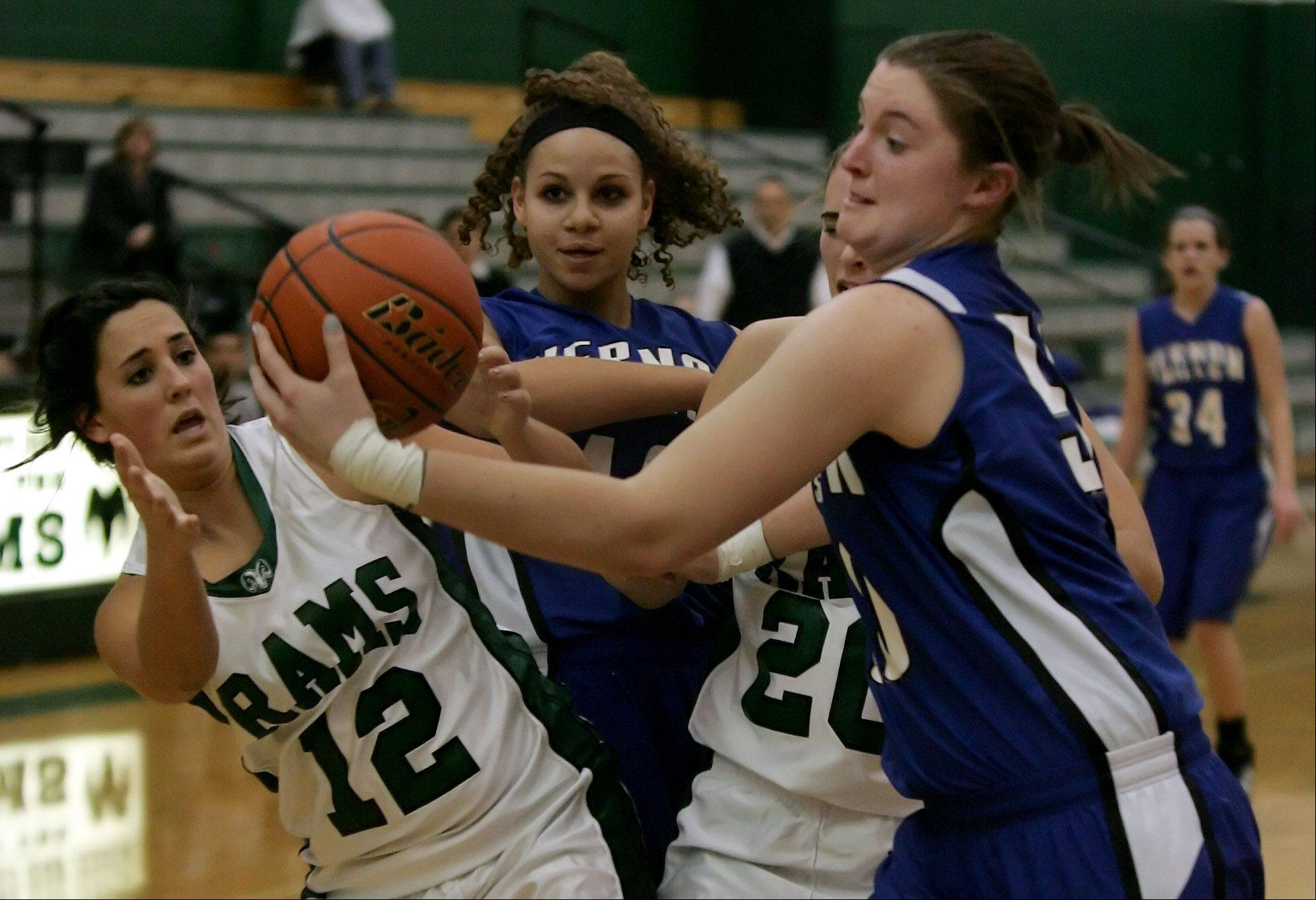 Vernon Hills' Meri Bennett-Swanson, right, steals the ball from Grayslake Central players Beth Arnold and Claire Brennan during Tuesday's basketball game in Grayslake.