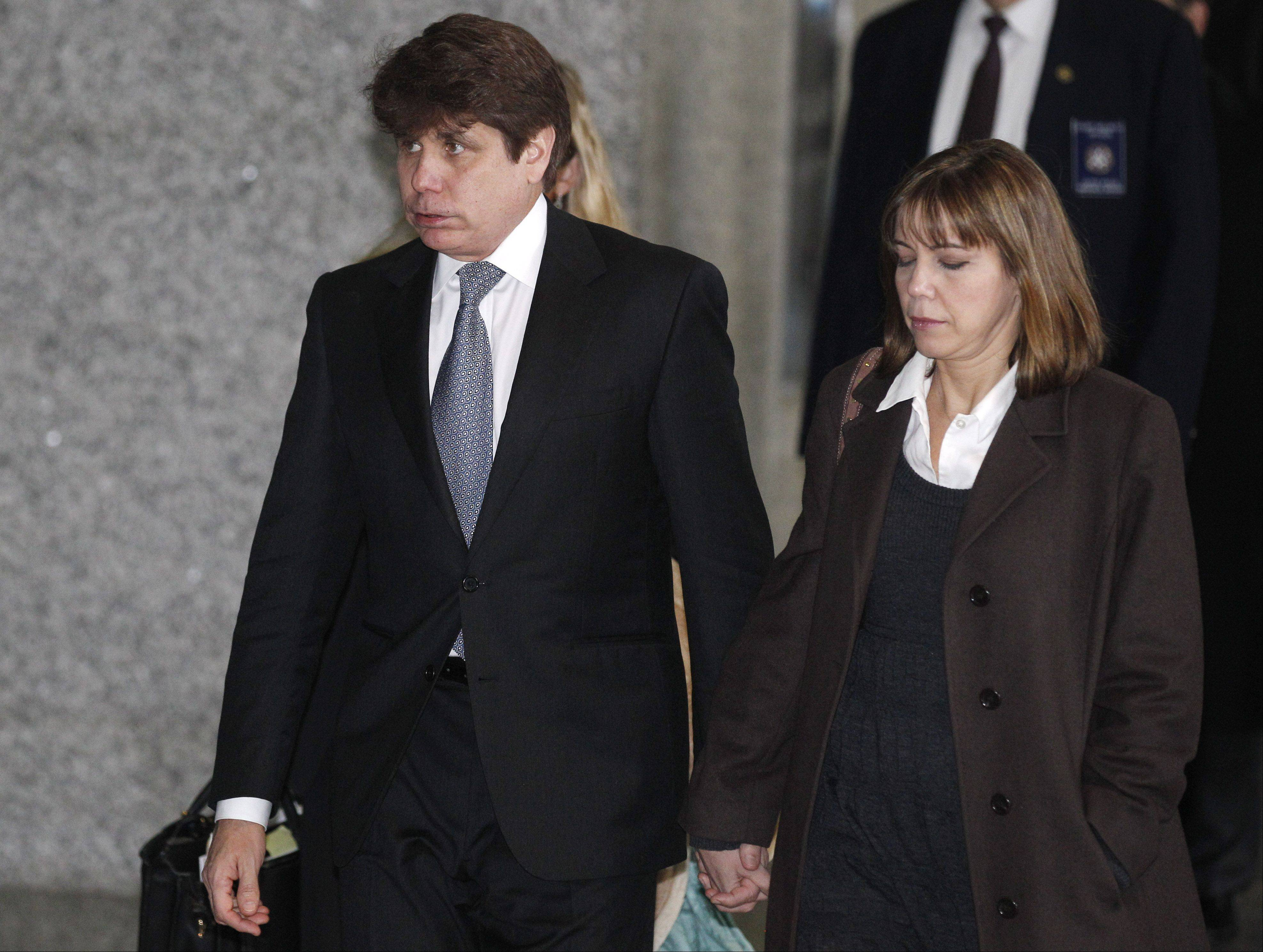 Former Gov. Rod Blagojevich  and his wife, Patti, leave the courtroom Wednesday.