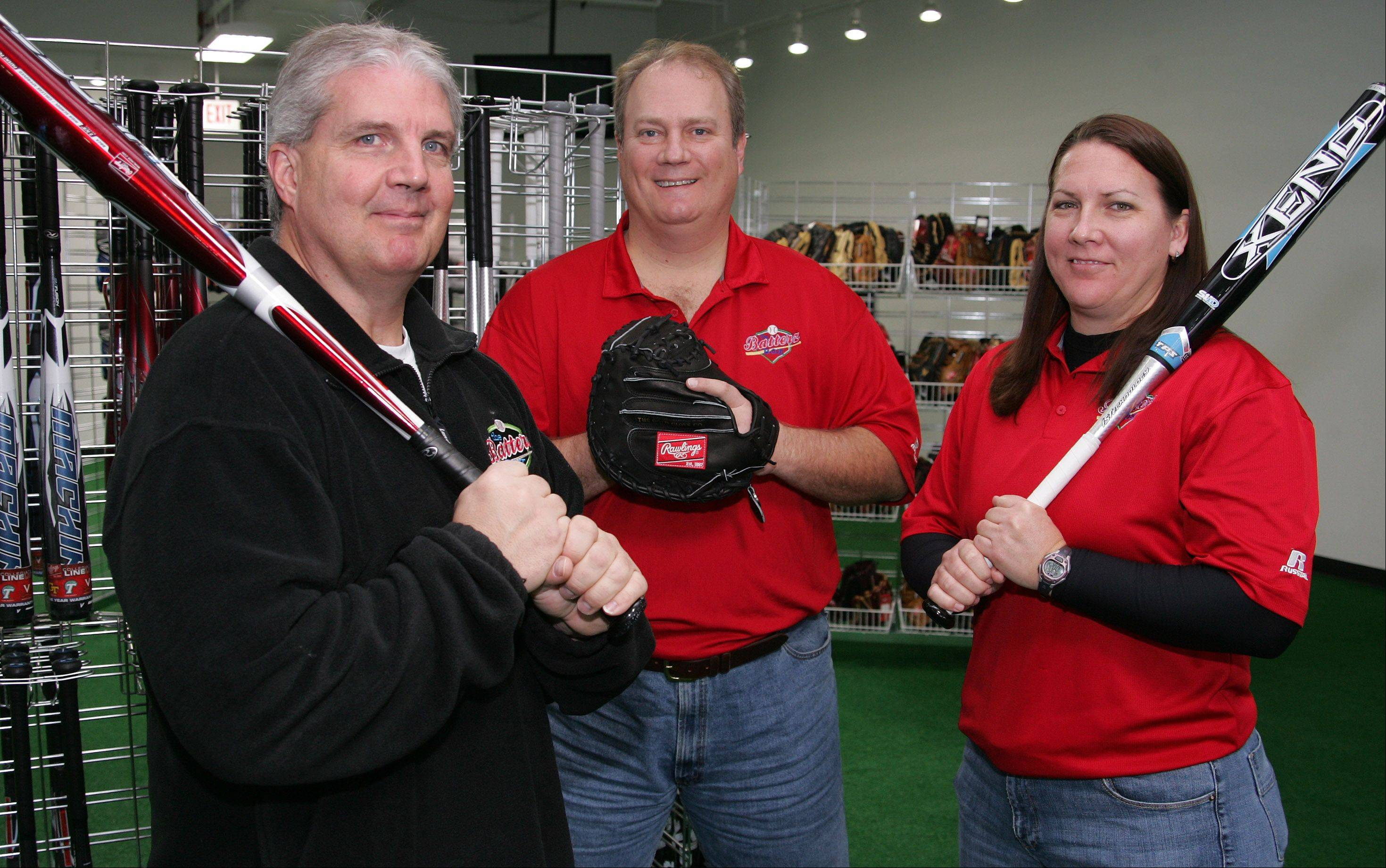 Rob Earhart, team sales manager; Mike Dutler, president, owner; and Michelle Oswald, director of softball, operate a new business in Libertyville, The Batterz Box.