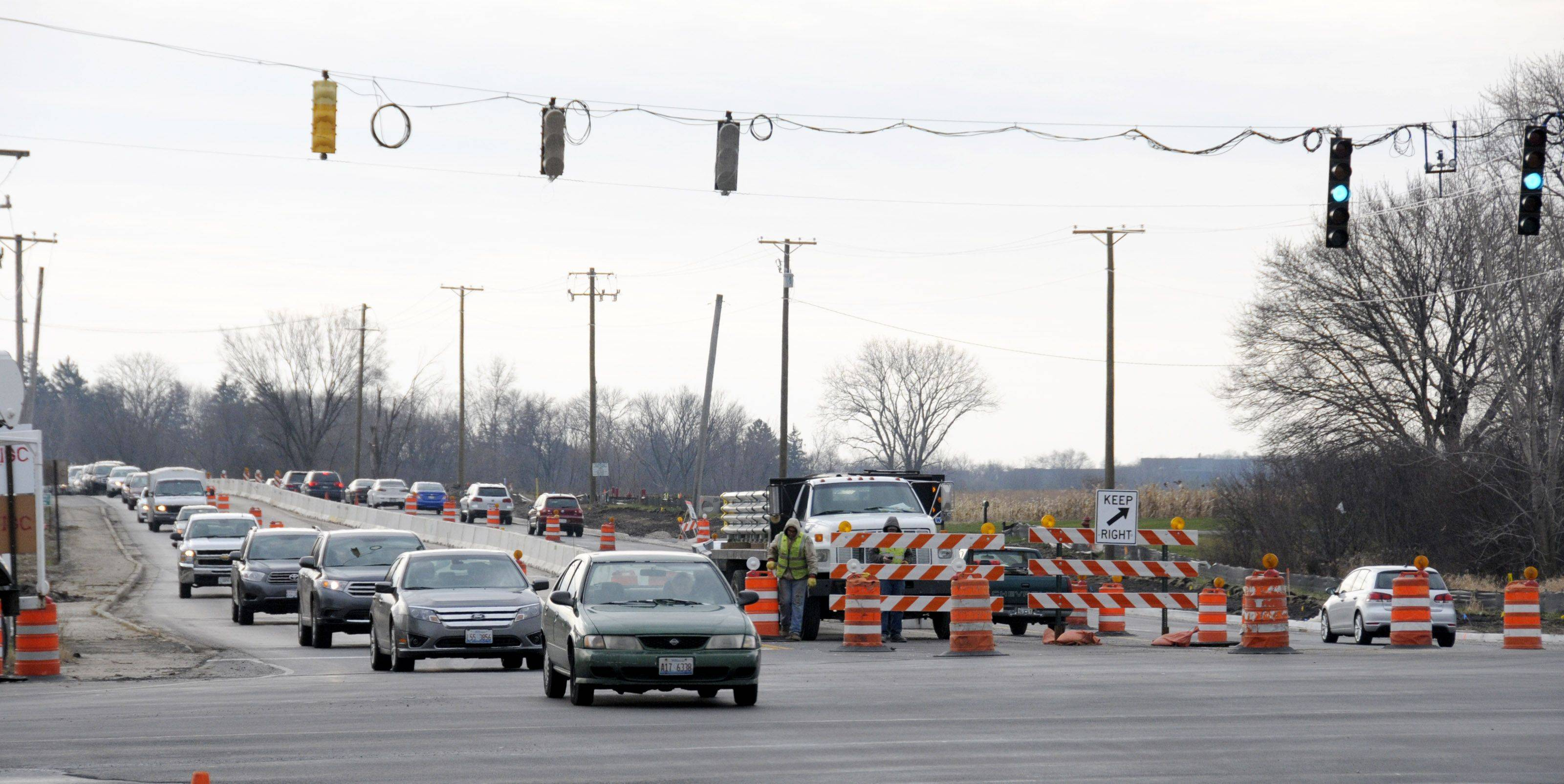 Drivers on Naperville Road in Wheaton funnel into a single lane in both directions Thursday at the intersection with Butterfield Road. Two lanes in each direction will be open by the time the project stops for the winter season at the end of today.