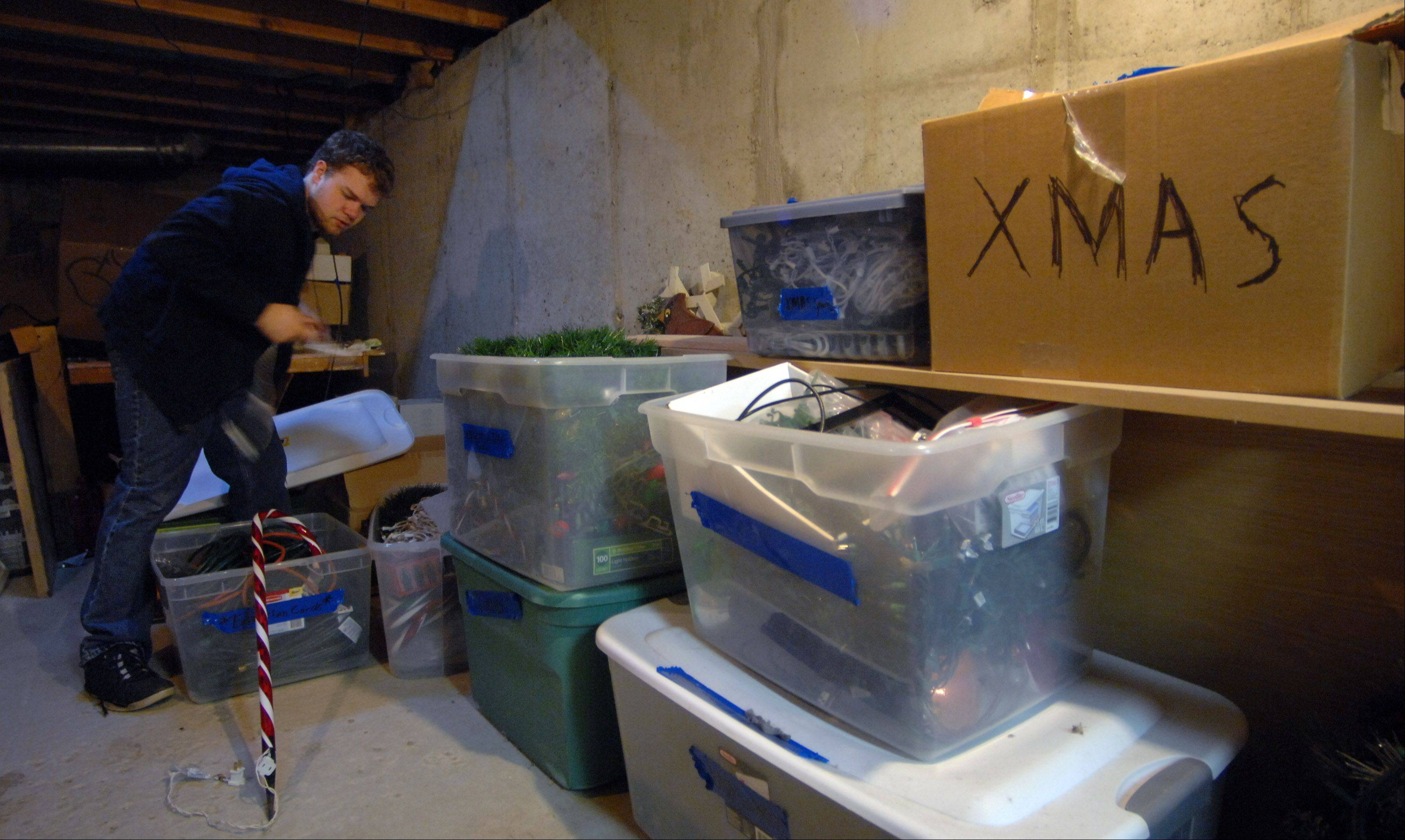Germann unpacks his Christmas lights from his storage area in the basement.