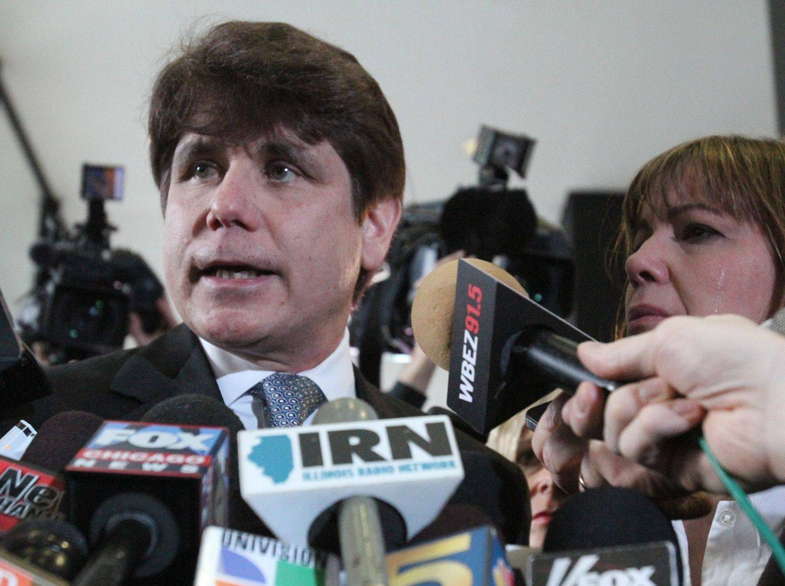 George LeClaire/gleclaire@dailyherald.com Former Governor Rod Blagojevich speaks to the press, with his wife Patti, after his sentencing hearing at the Dirksen Federal Building in Chicago on Wednesday, December 7th.