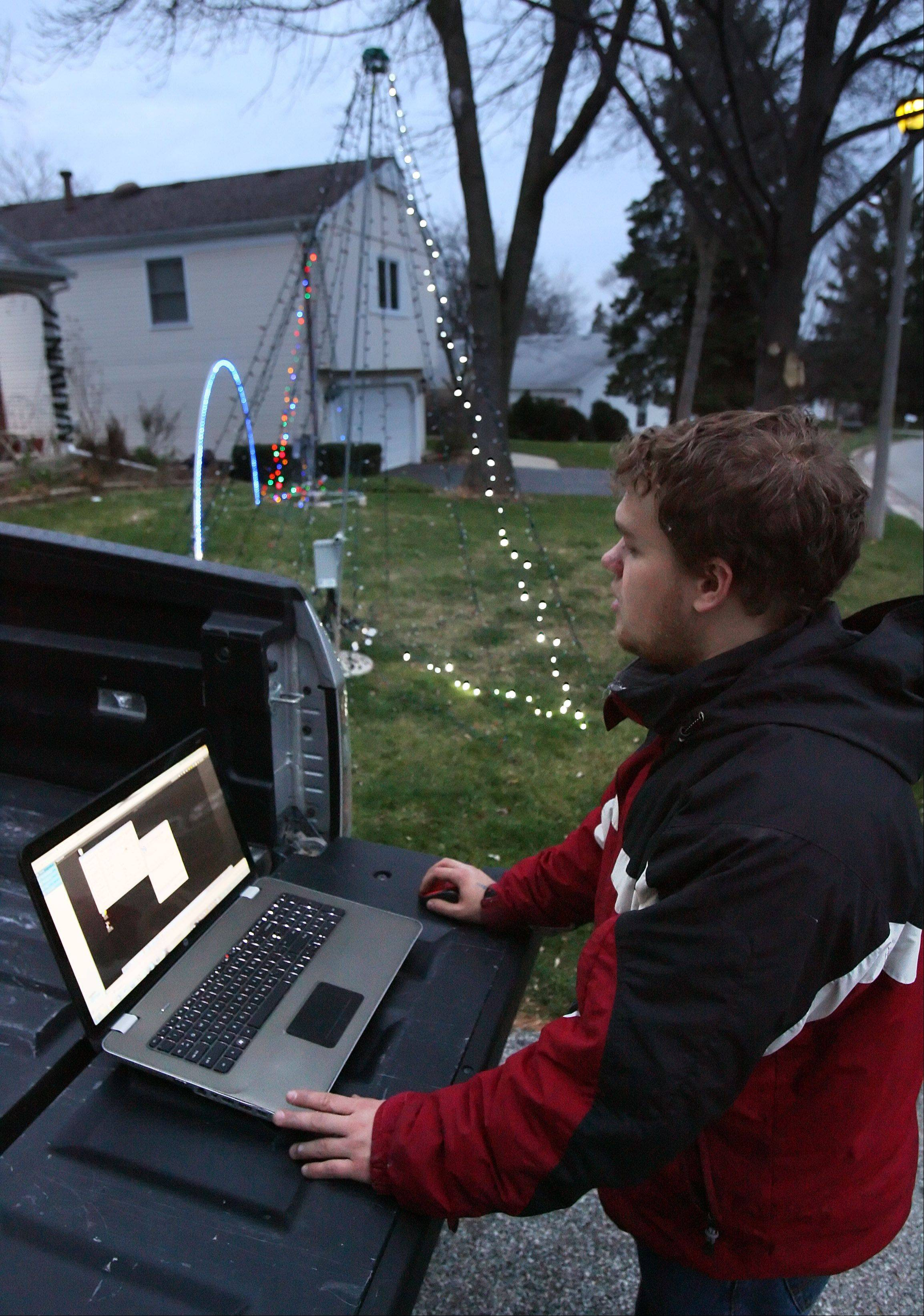 Gurnee resident Adam Germann uses his computer to control the lights outside his house.