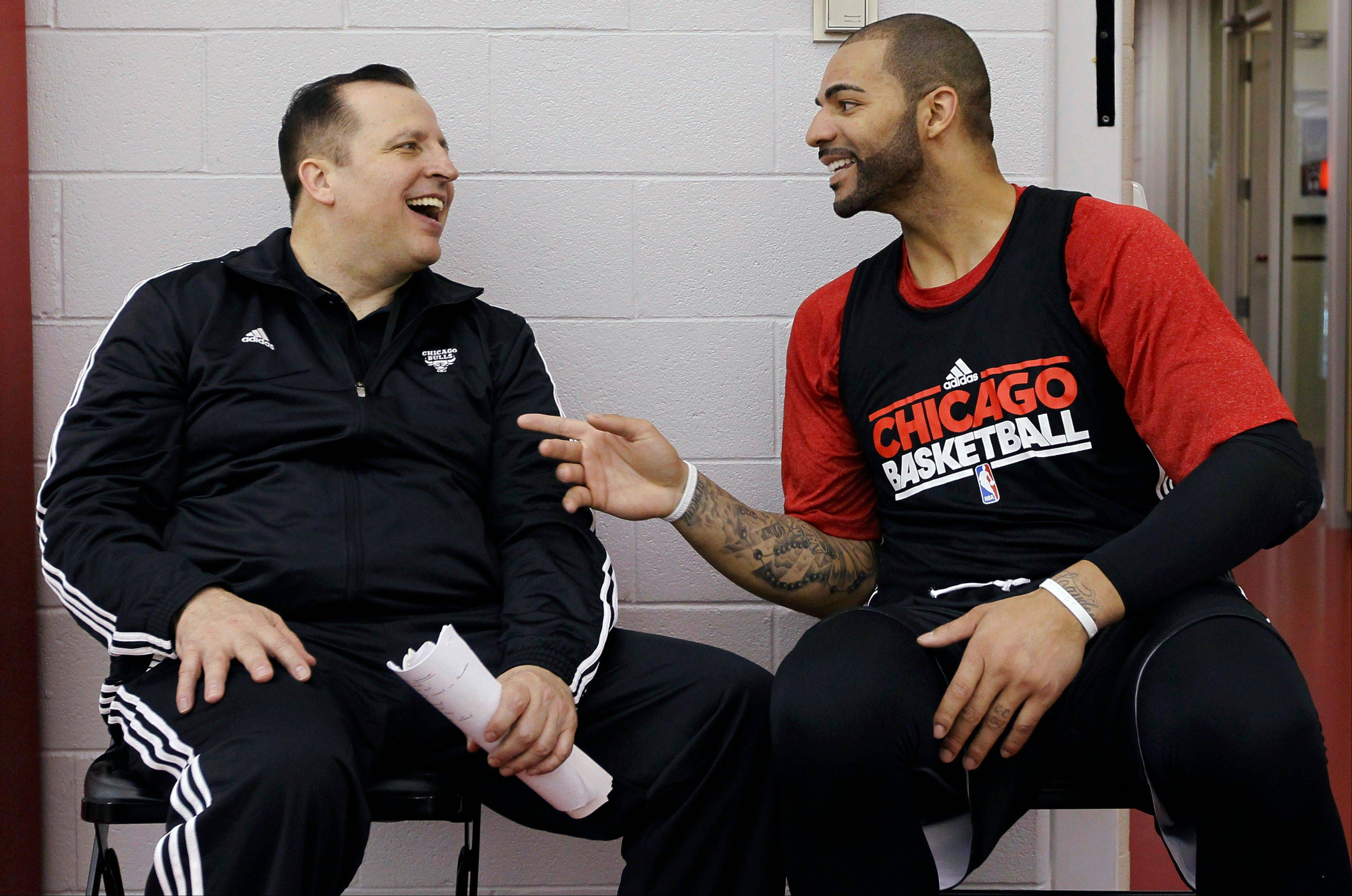 Bulls coach Tom Thibodeau, left, shares a laugh with Carlos Boozer on Friday.