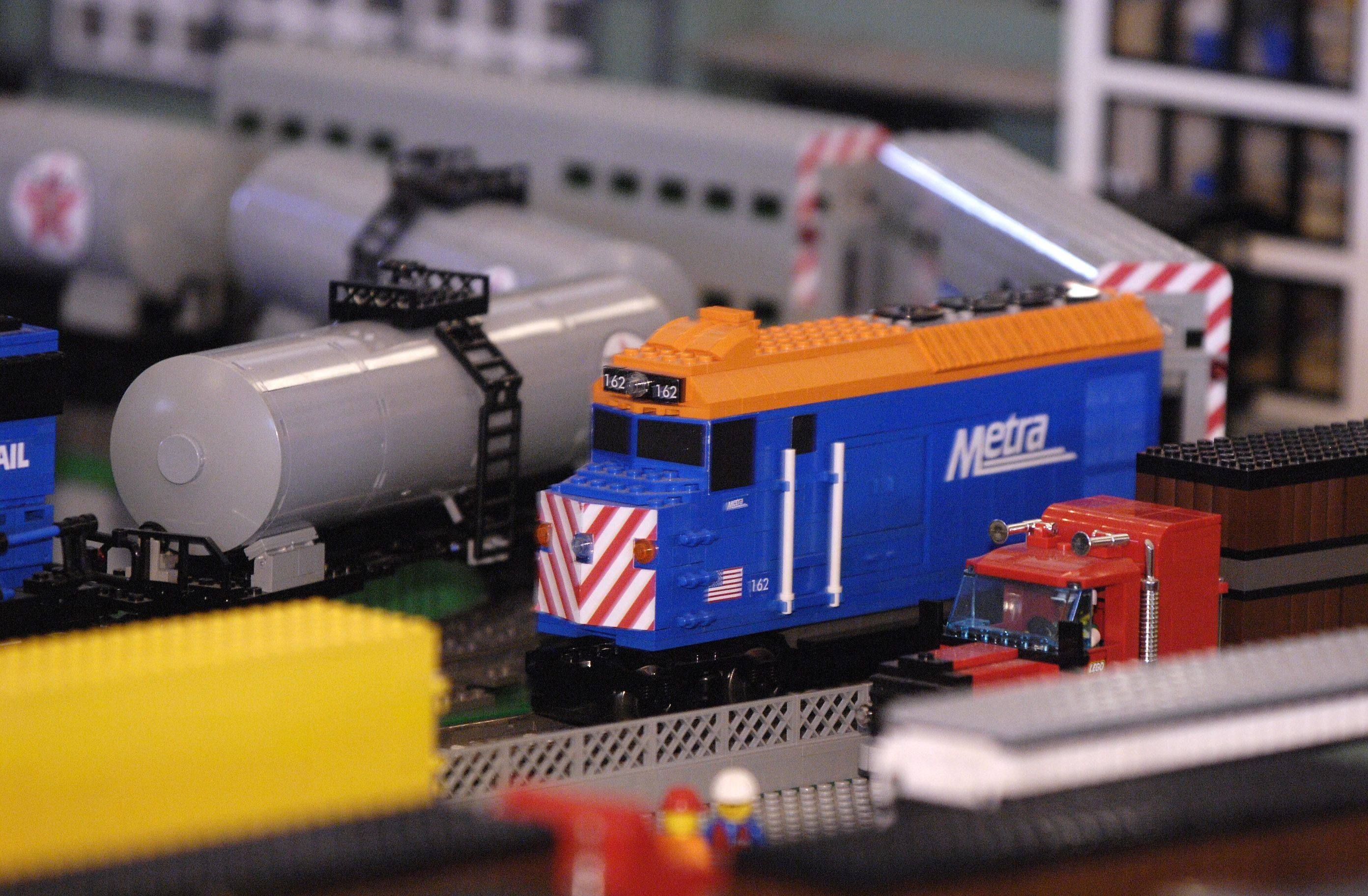 A Metra train races around a Lego cityscape Sunday during the Lego Train Show at Cantigny Park in Wheaton.
