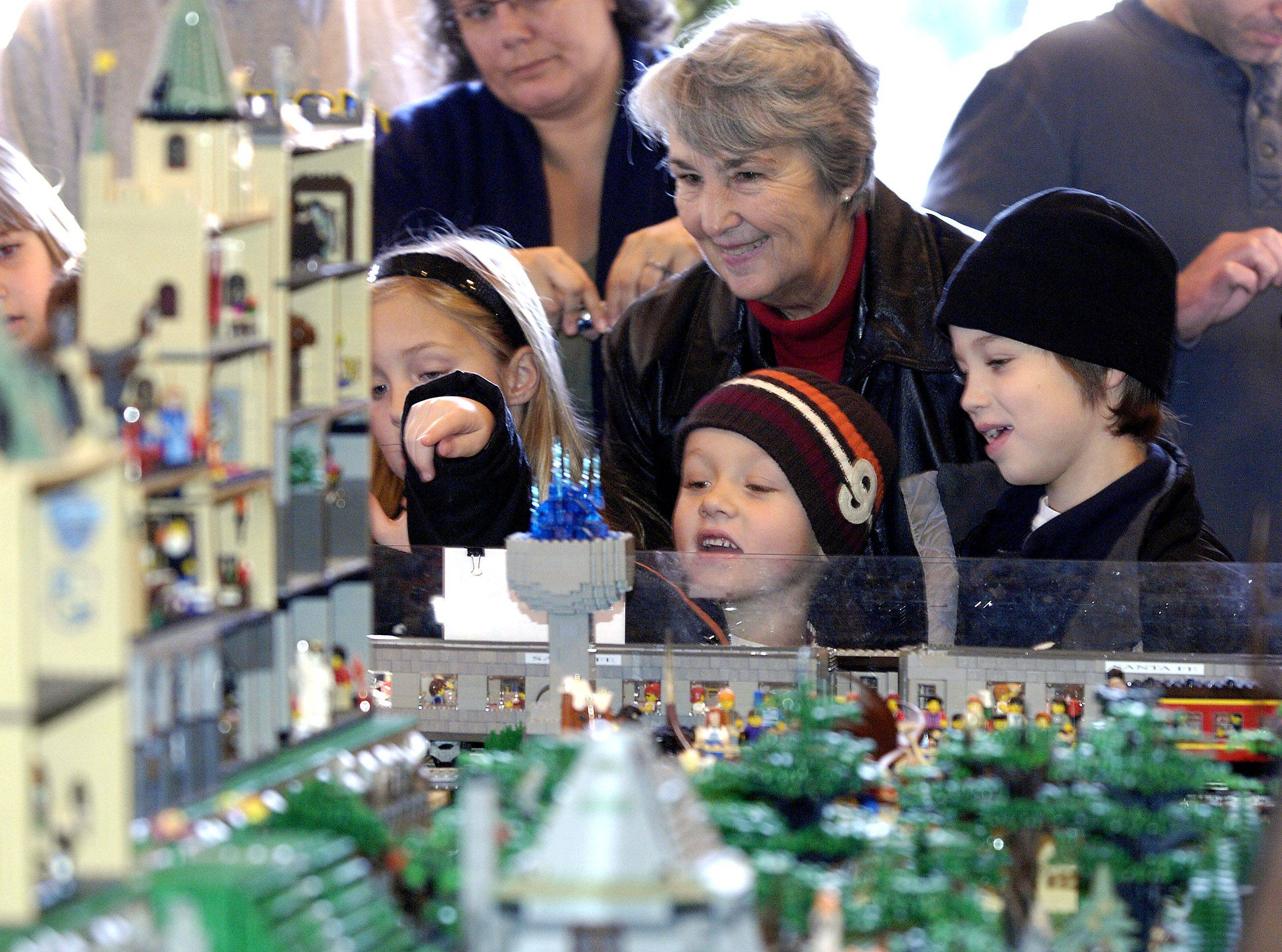Jan Foster and her grandchildren Payton, 10, Troy, 6, and Colin Foster, 8, check out one of the many train layouts Sunday at the Lego Train Show at Cantigny Park in Wheaton.