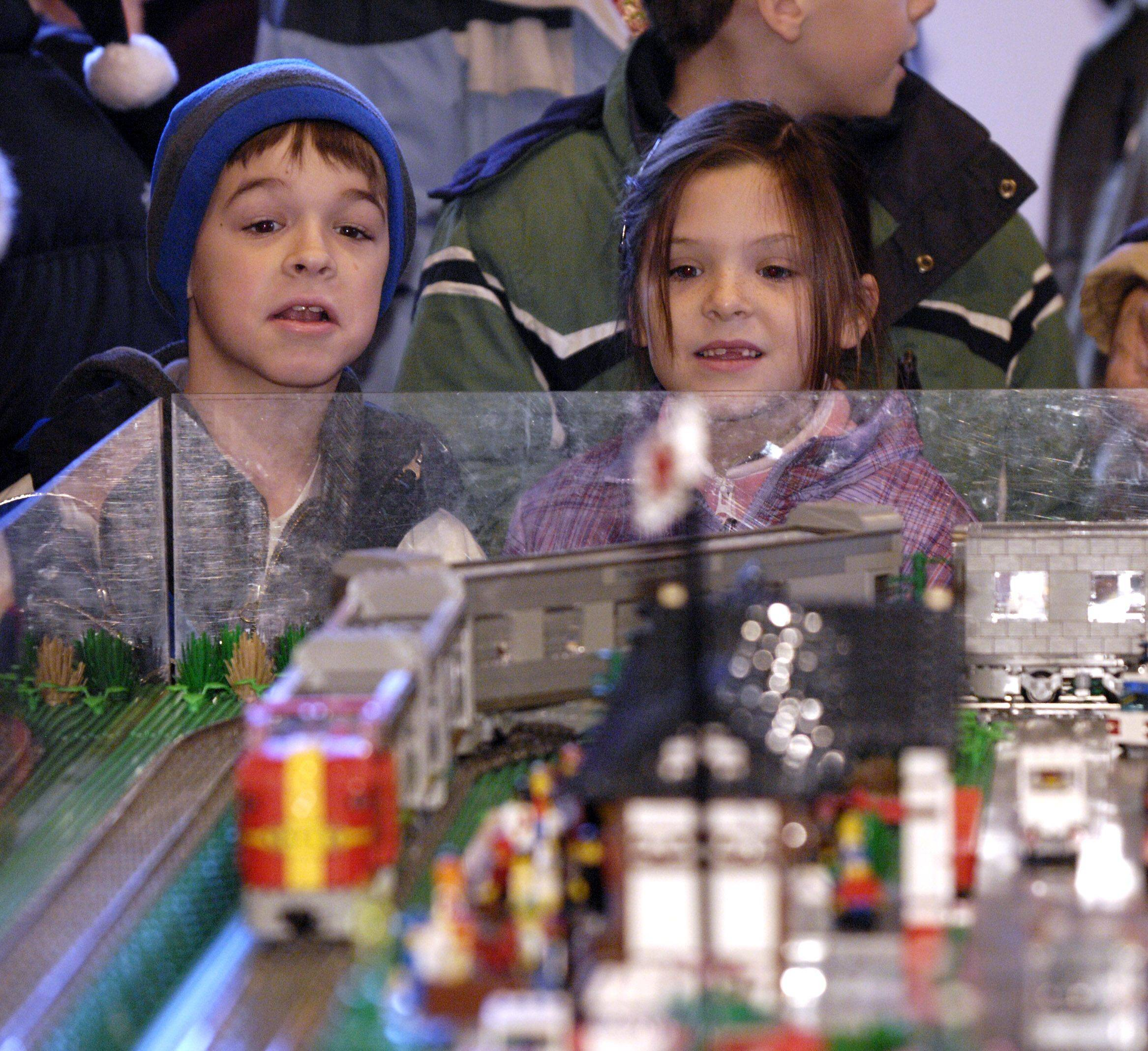 Cousins Nathan Riess, 6, and Emma Liptak, 8, check out one of the many train layouts Sunday during the Lego Train Show at Cantigny Park in Wheaton.