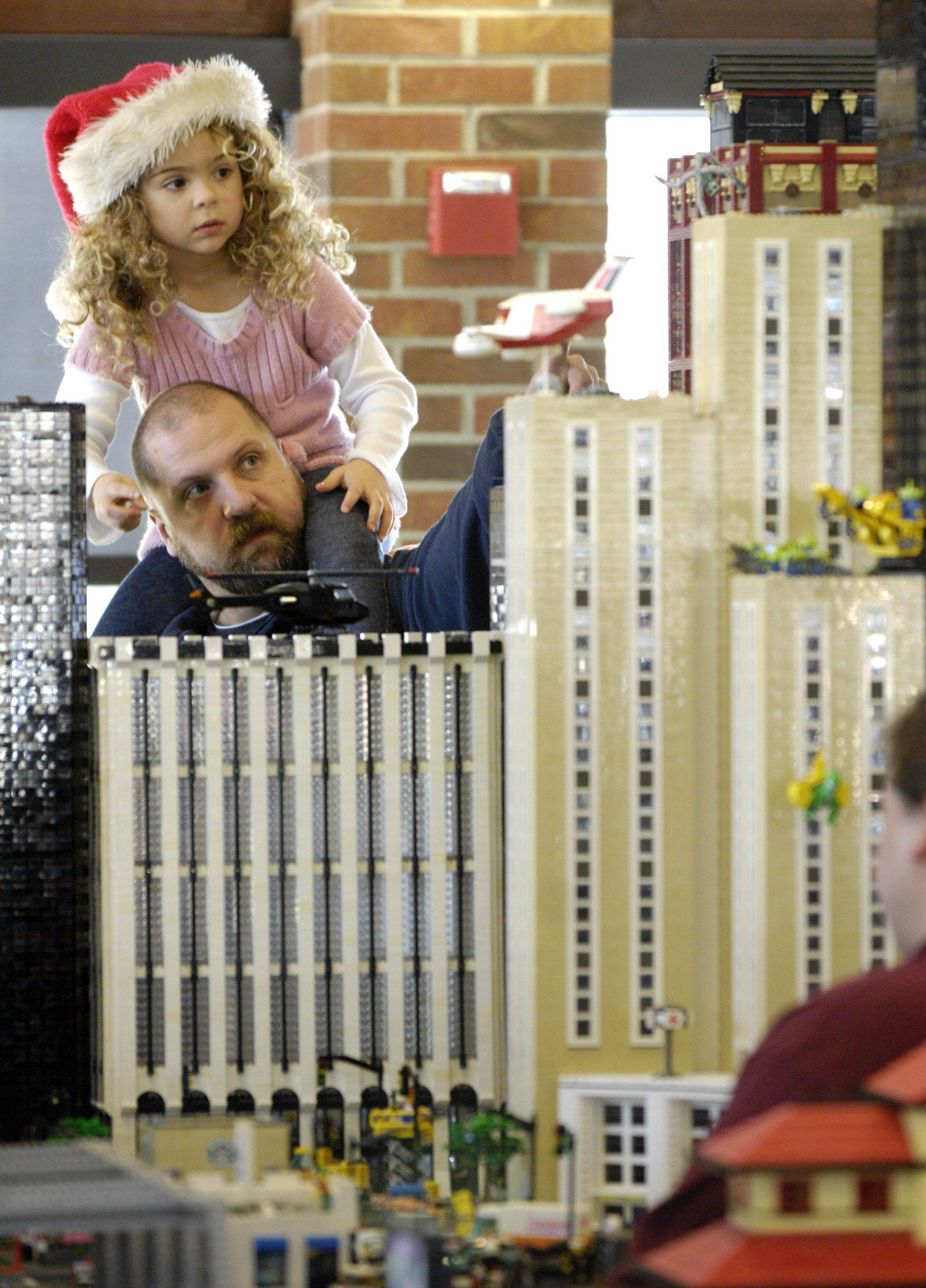 Joe Fedinec and his daughter, Hannah, 5, of Woodridge peer up at the skyscrapers made of Legos during the Lego Train Show Sunday at Cantigny Park in Wheaton.