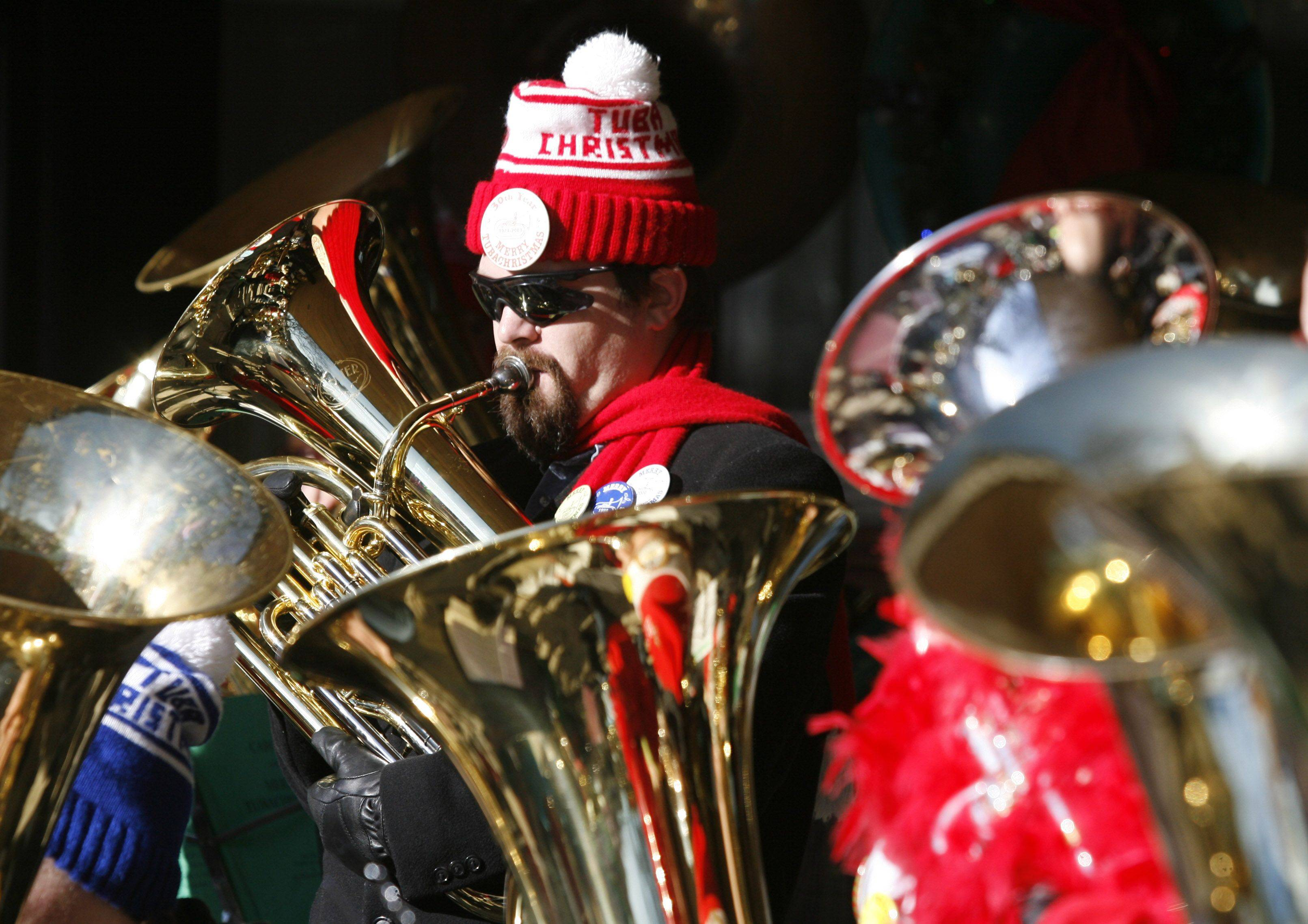 Byron Foret of Morris participates in the annual Tuba Christmas concert Saturday in Naperville. Low brass players performed 13 carols and let listeners sing along.