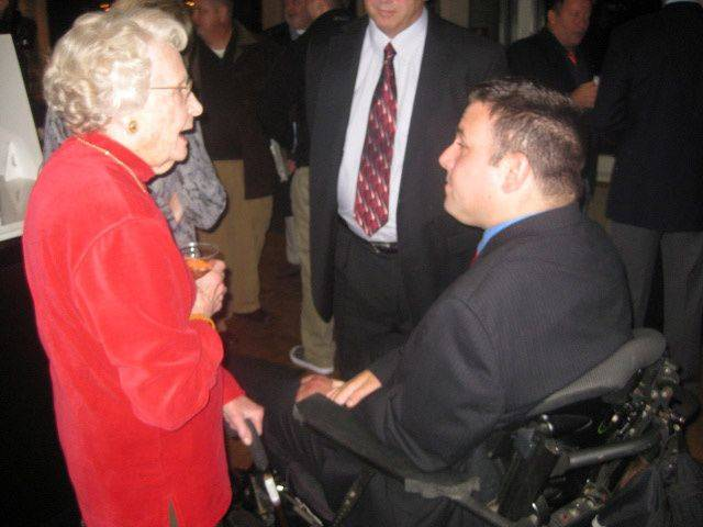 Virginia McCaskey, matriarch of the Chicago Bears' owners, chats with J.J. O'Connor of Mount Prospect during a fundraiser at the Bears' training facility in Halas Hall on behalf of the Gridiron Alliance, a charity that advocates for safety in sports and reaches out to young athletes who have suffered catastrophic injuries.
