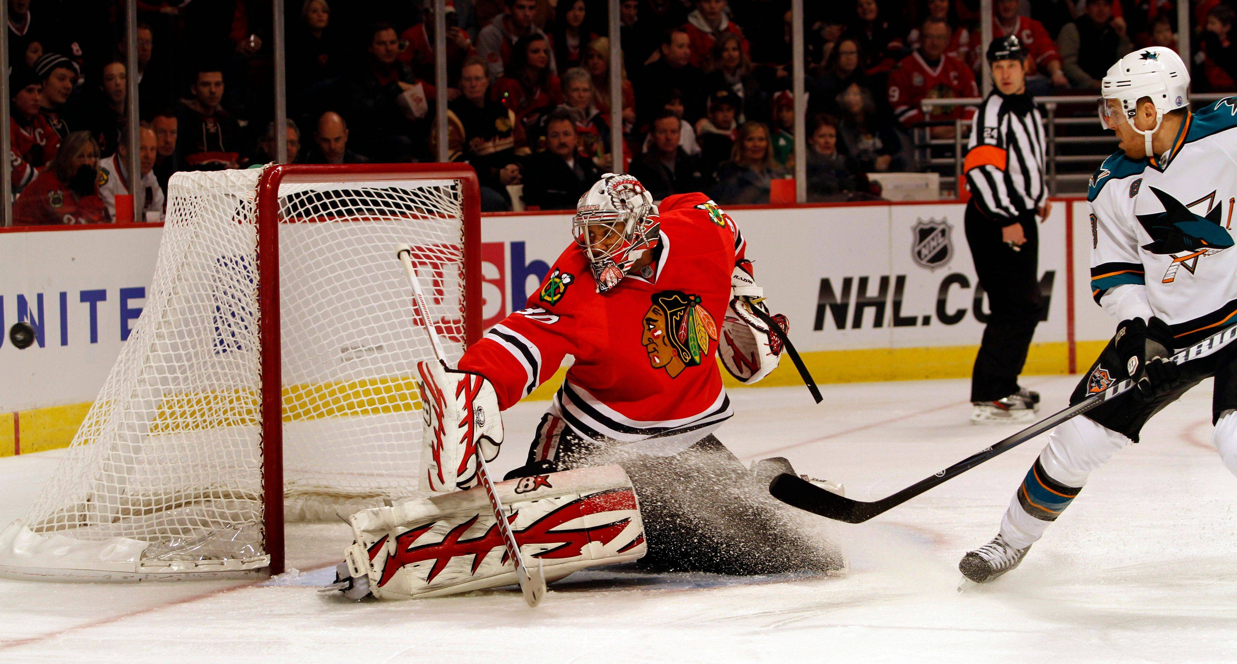 Goalie Ray Emery kept the Blackhawks close to the Sharks on Sunday, making 31 of his 35 saves in the first 40 minutes. Here he stopped a shot from Joe Pavelski in the first period.