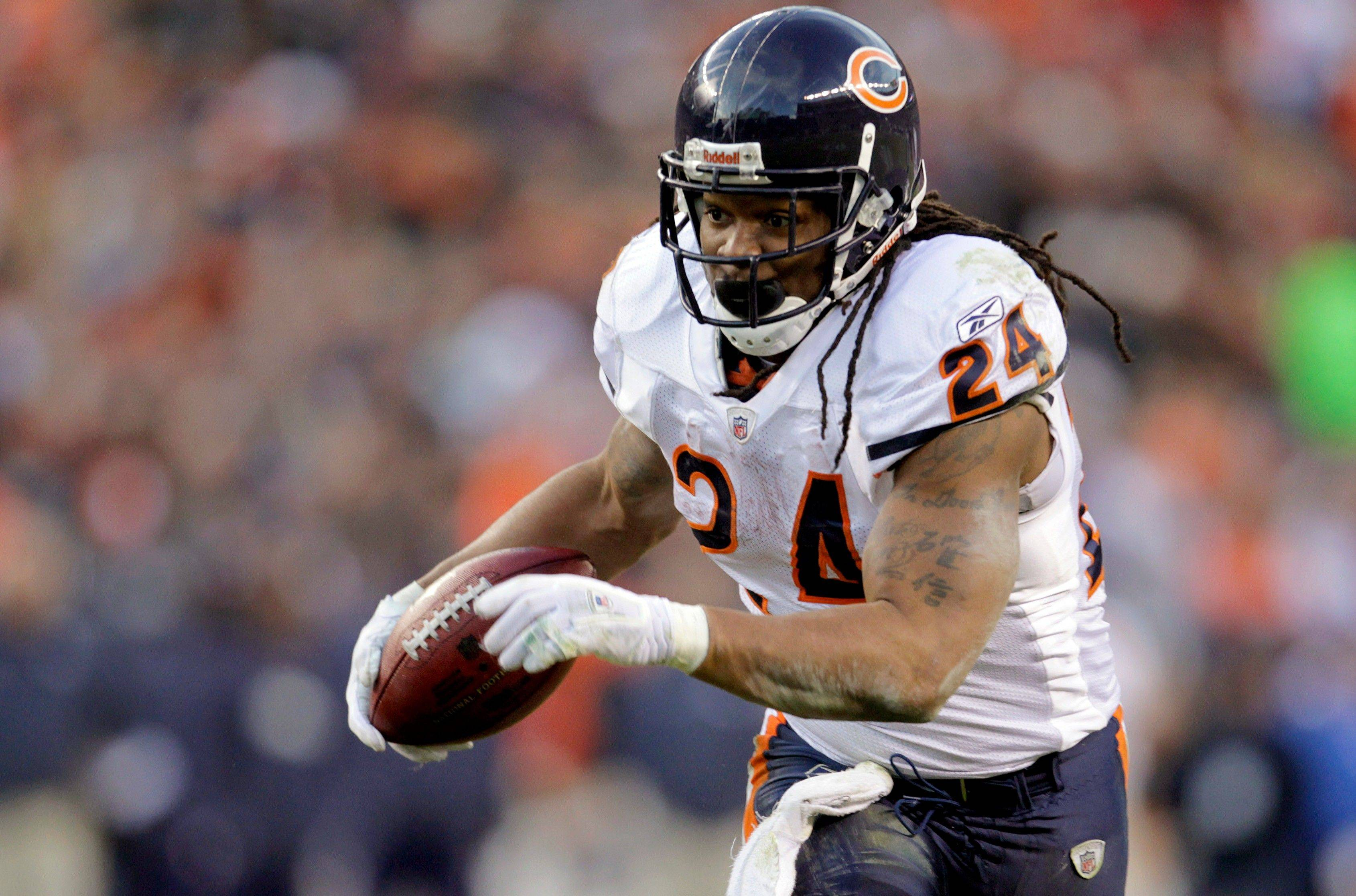 Chicago Bears running back Marion Barber (24) runs for a touchdown against the Denver Broncos in the third quarter.