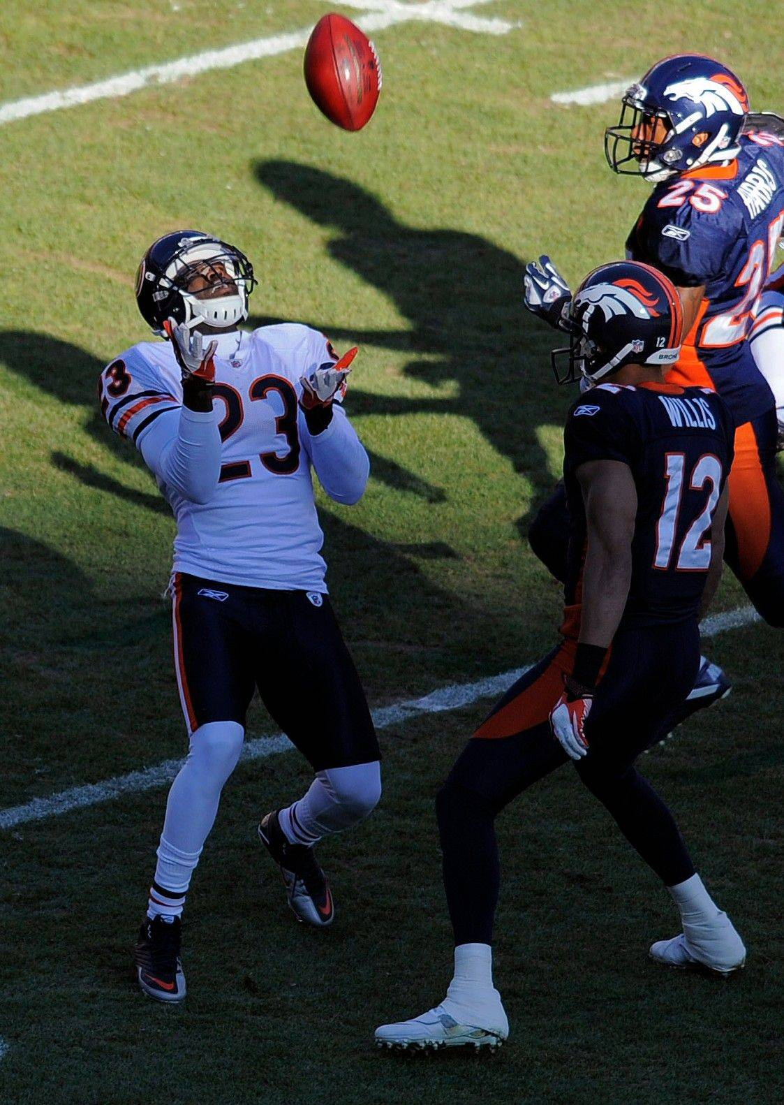 Chicago Bears wide receiver Devin Hester (23) catches a punt in the first quarter.