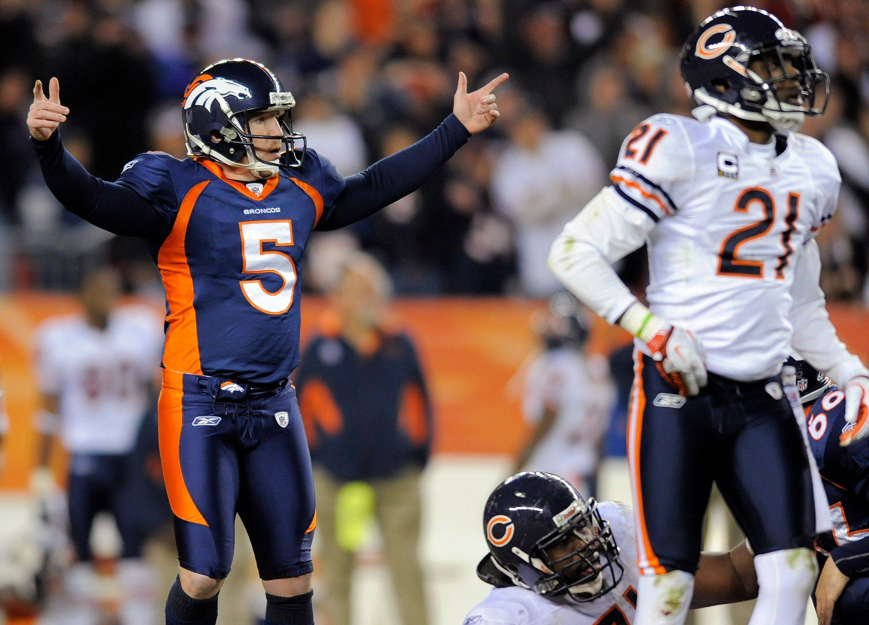 Denver Broncos kicker Matt Prater (5) reacts as his 59-yard field goal attempt with 8 seconds remaining in the fourth quarter goes through the uprights as Chicago Bears defensive back Corey Graham (21) looks on in an NFL football game.
