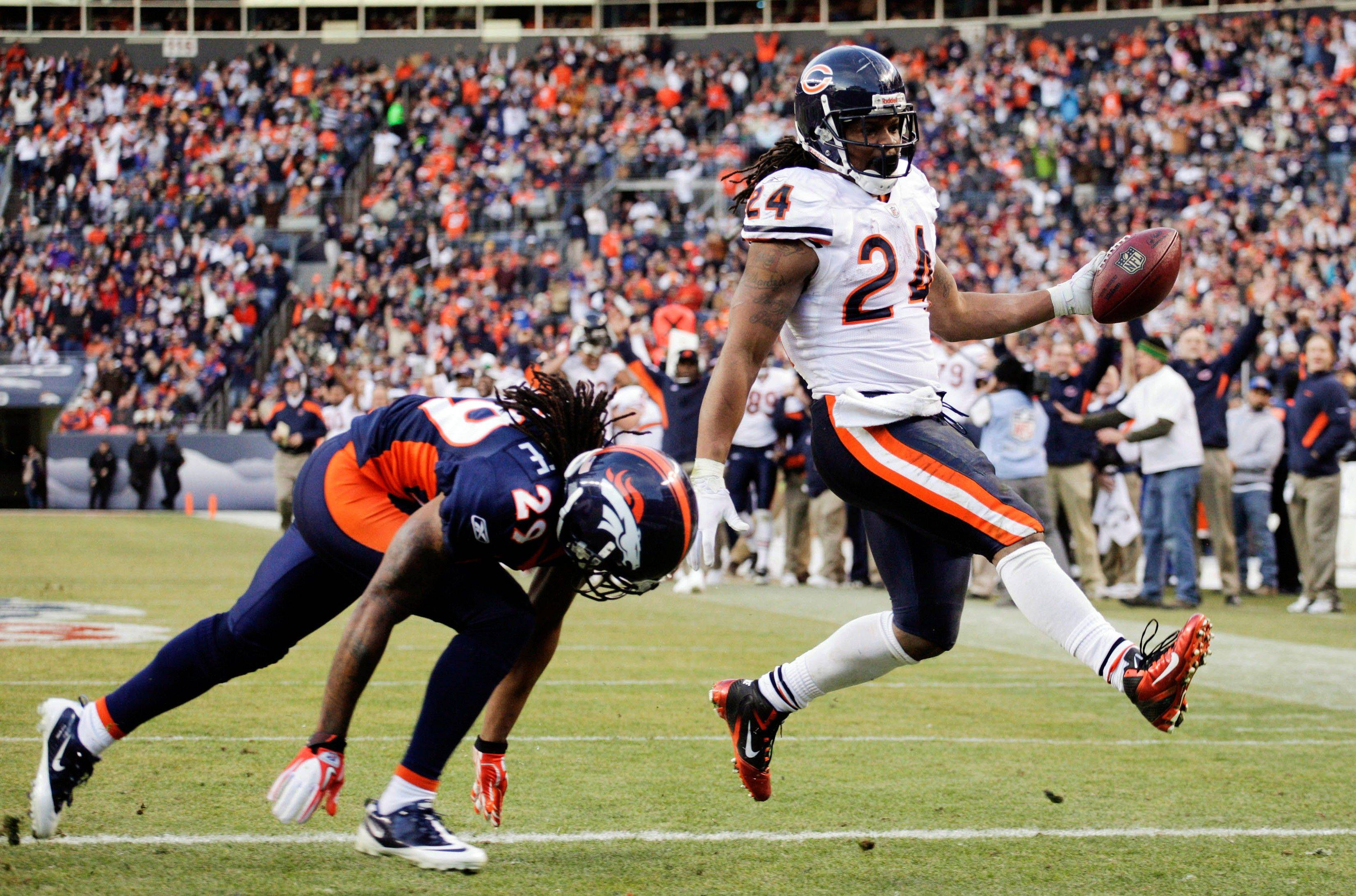 Chicago Bears running back Marion Barber (24) crosses the goal line for a touchdown in front of Denver Broncos defensive back Jonathan Wilhite (29) in the third quarter.