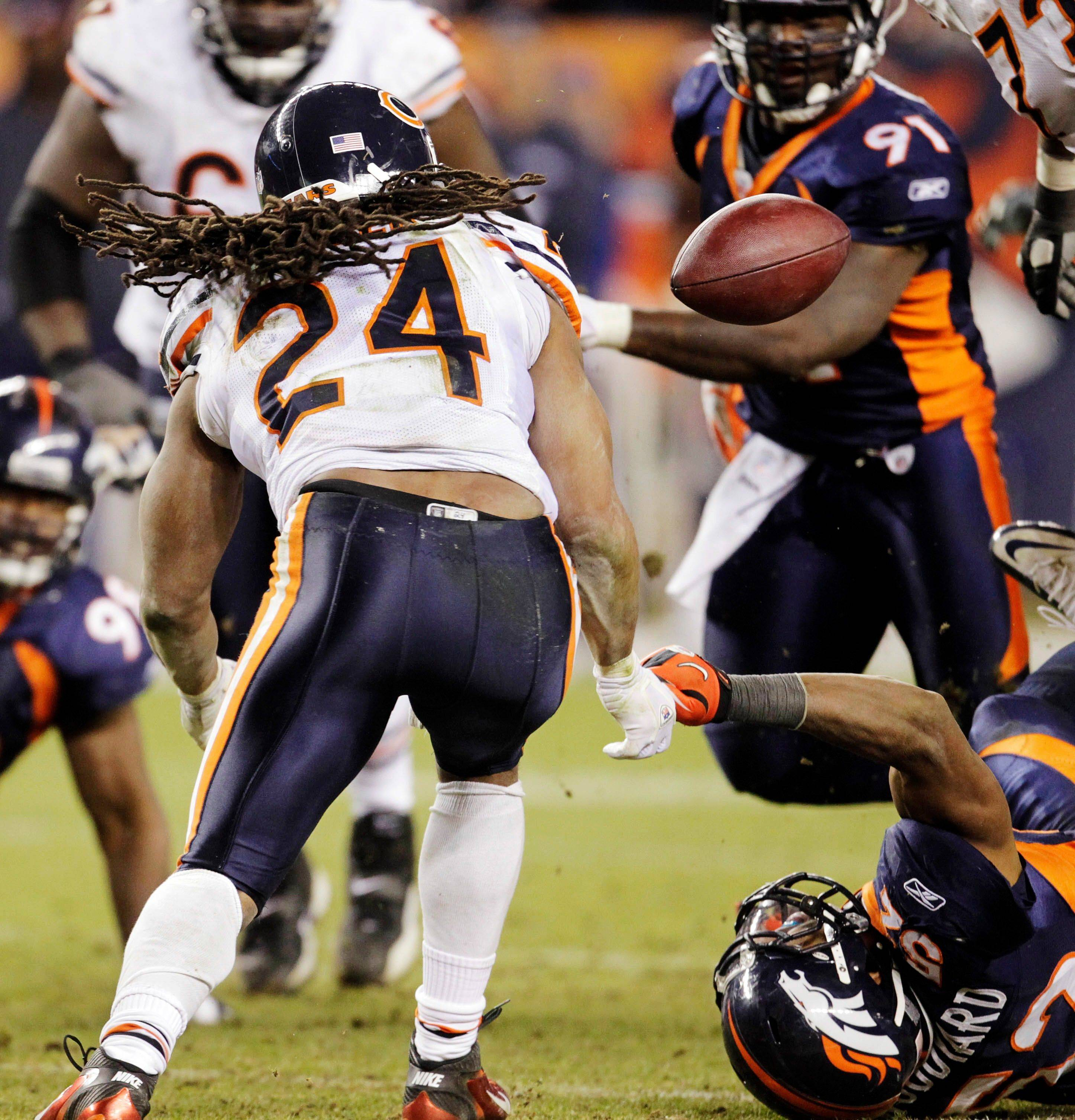 Chicago Bears running back Marion Barber (24) fumbles the ball against the Denver Broncos in overtime. Denver recovered the ball on the play. Denver won 13-10.