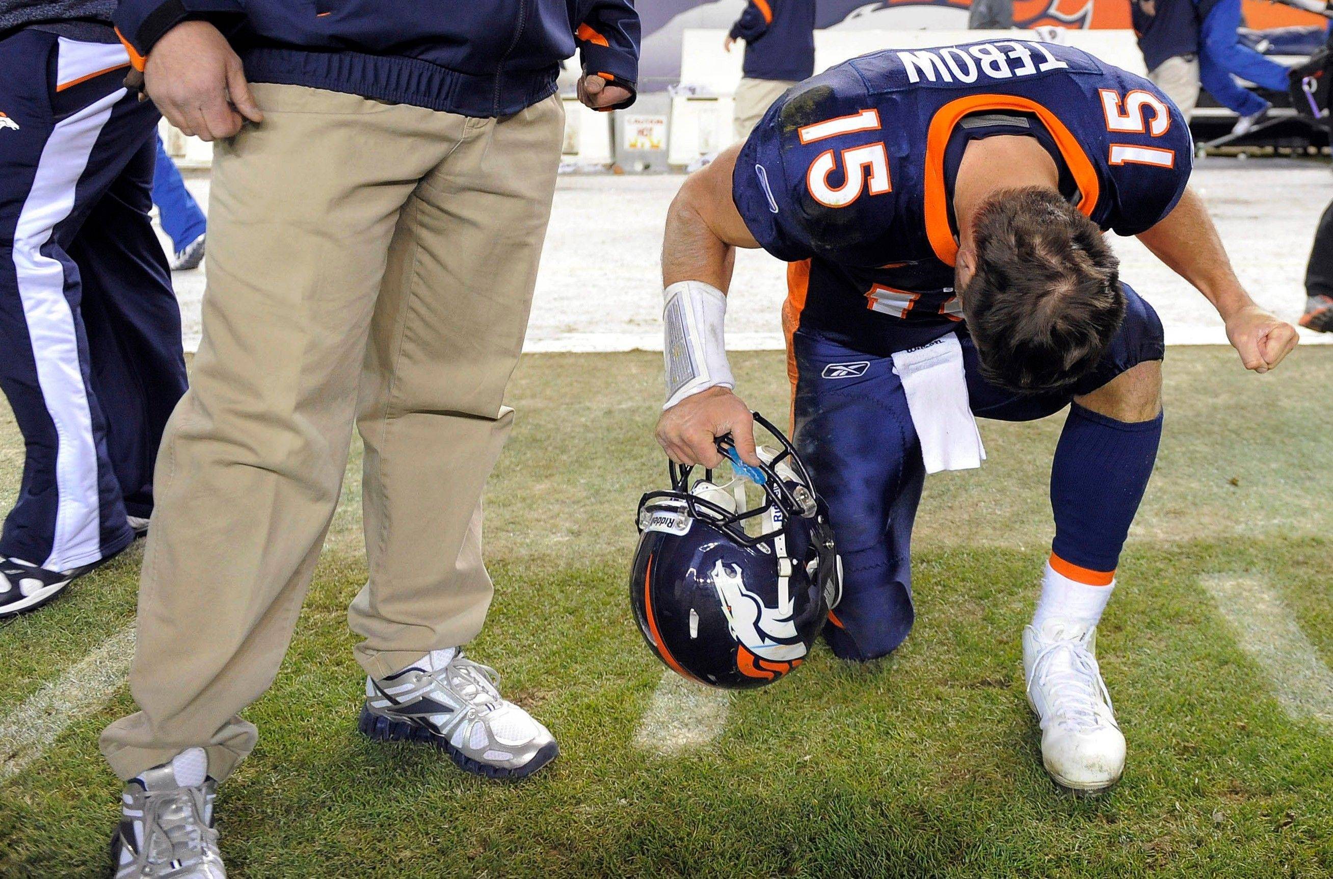 Denver Broncos quarterback Tim Tebow (15) reacts after kicker Matt Prater (5) kicked a 51-yard field goal to win the game in overtime over the Chicago Bears.