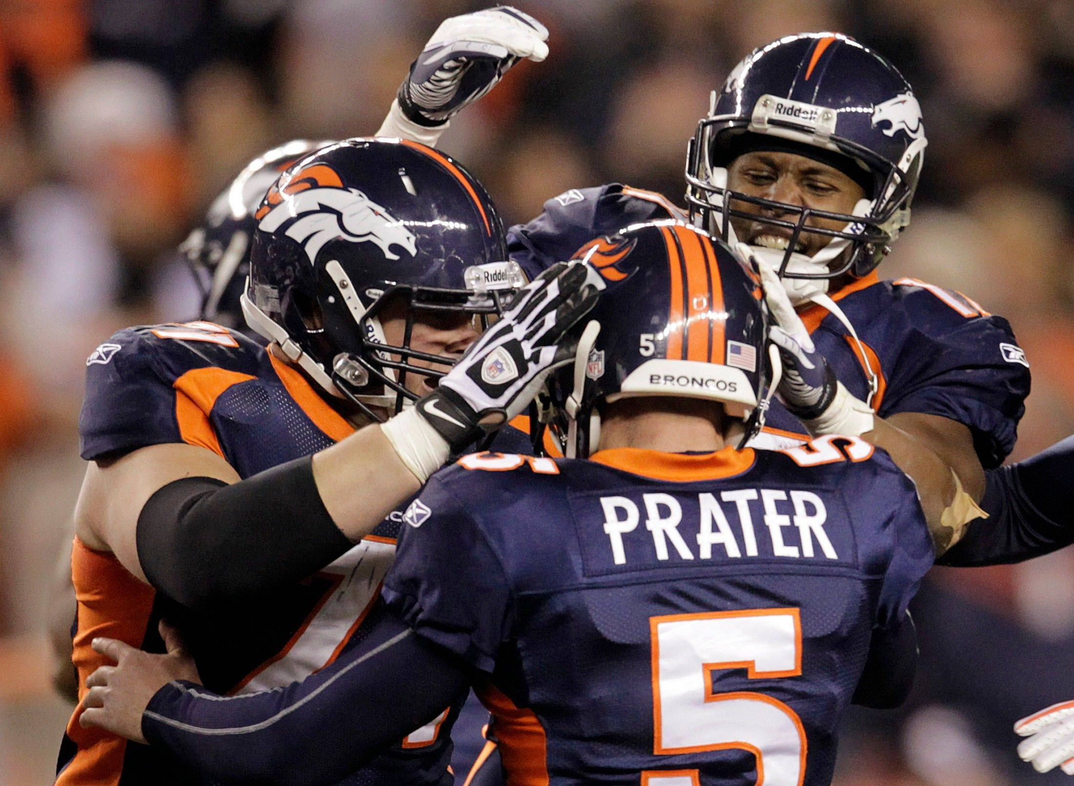 Denver Broncos kicker Matt Prater (5) is congratulated by teammates after kicking a 59-yard field goal at the end of the fourth quarter.