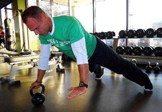 Kettlebell push-ups test your balance and strength.