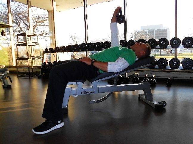 Keep your core engaged the whole time while performing the kettlebell sit-up/standup.