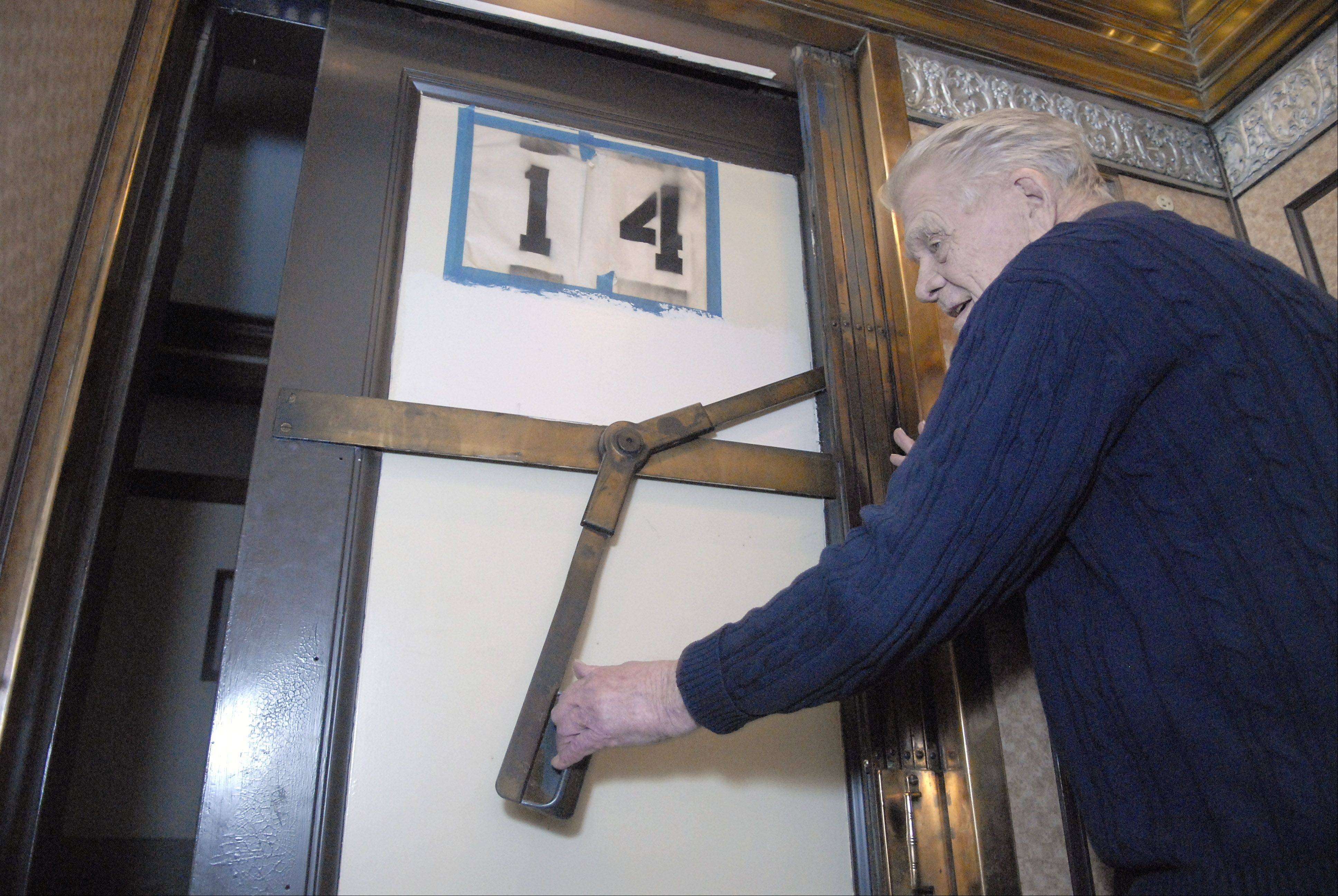 Allan L. Wudi is the morning elevator operator at the Elgin Tower Building. There is a gate and main door that has to be opened at each stop.