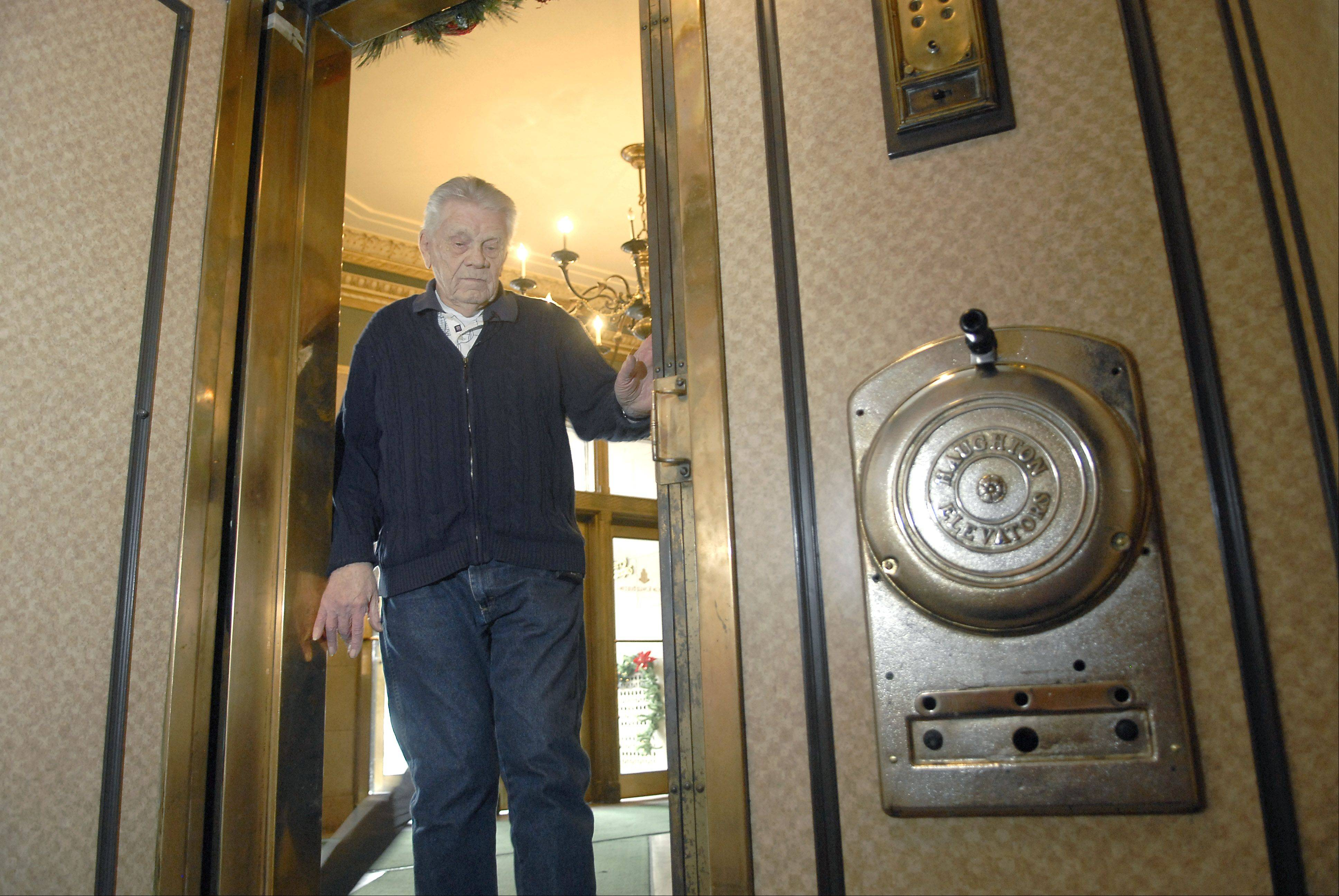 Allan L. Wudi, age 87, is the morning elevator operator at the Elgin Tower Building. He has worked at the building for the past 12 years and doesn't plan to quit anytime soon.