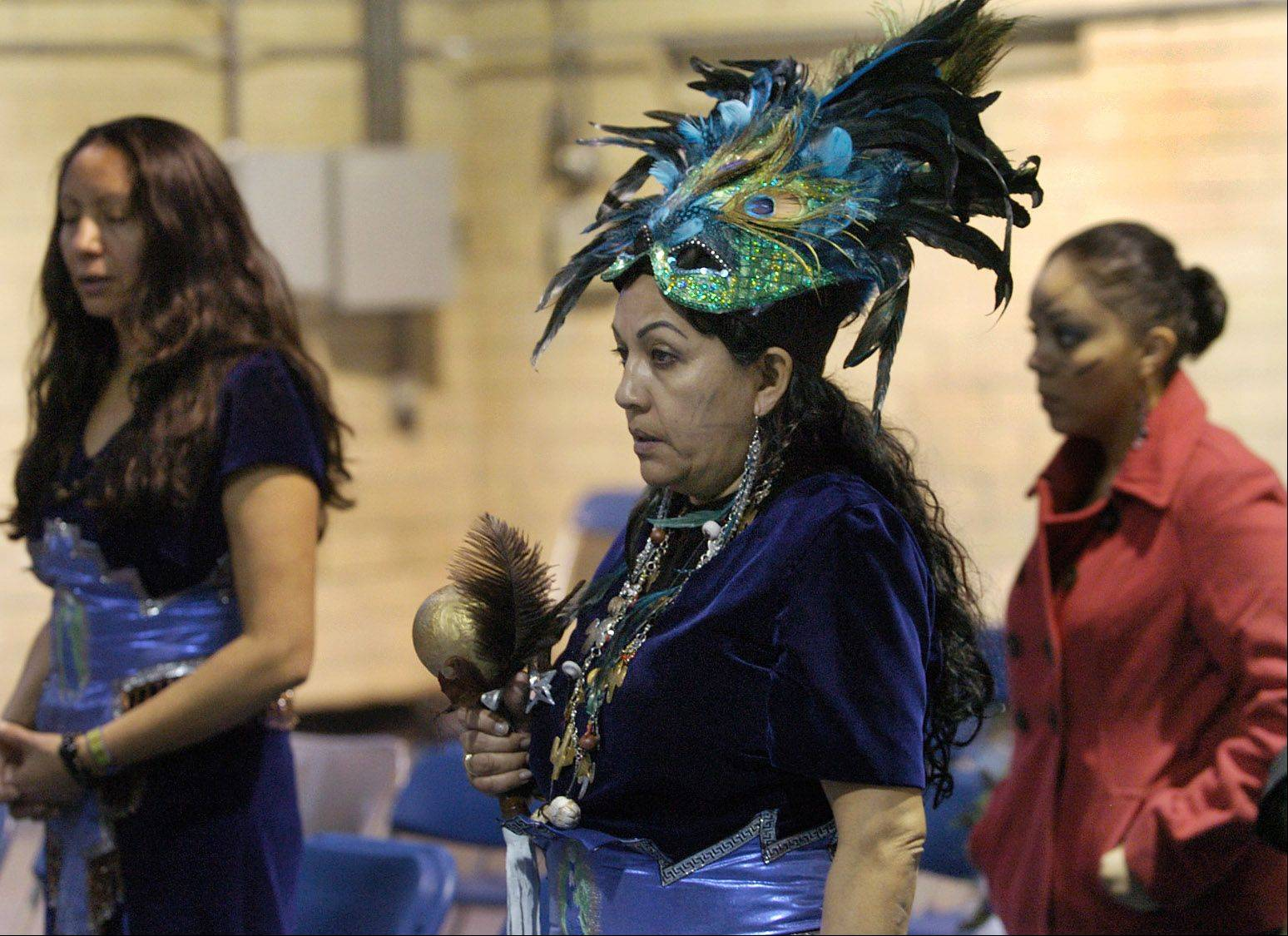 A woman in traditional Mexican head wear attends Mass at the Shrine of Our Lady of Guadalupe in Des Plaines.