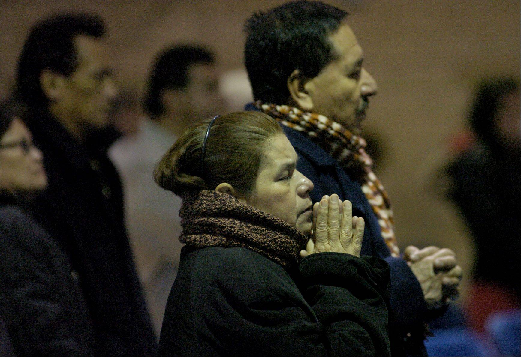 A woman prays during the 9 a.m. Mass at the Shrine of Our Lady of Guadalupe in Des Plaines.